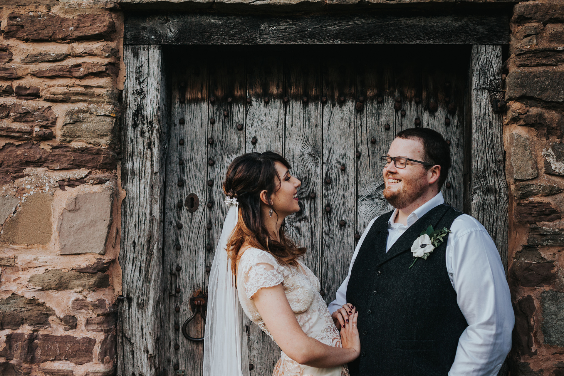 Bride and Groom portrait in front of stable door, Dewsall Court.