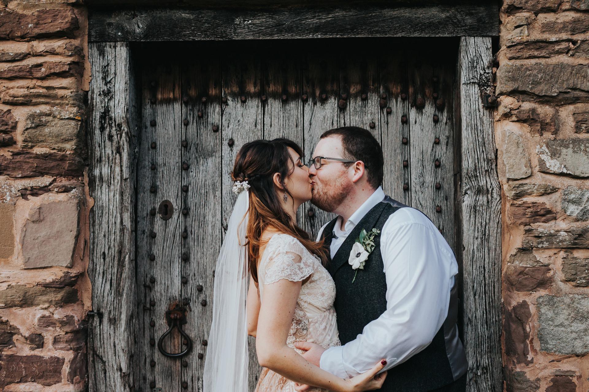 Bride and groom kiss.
