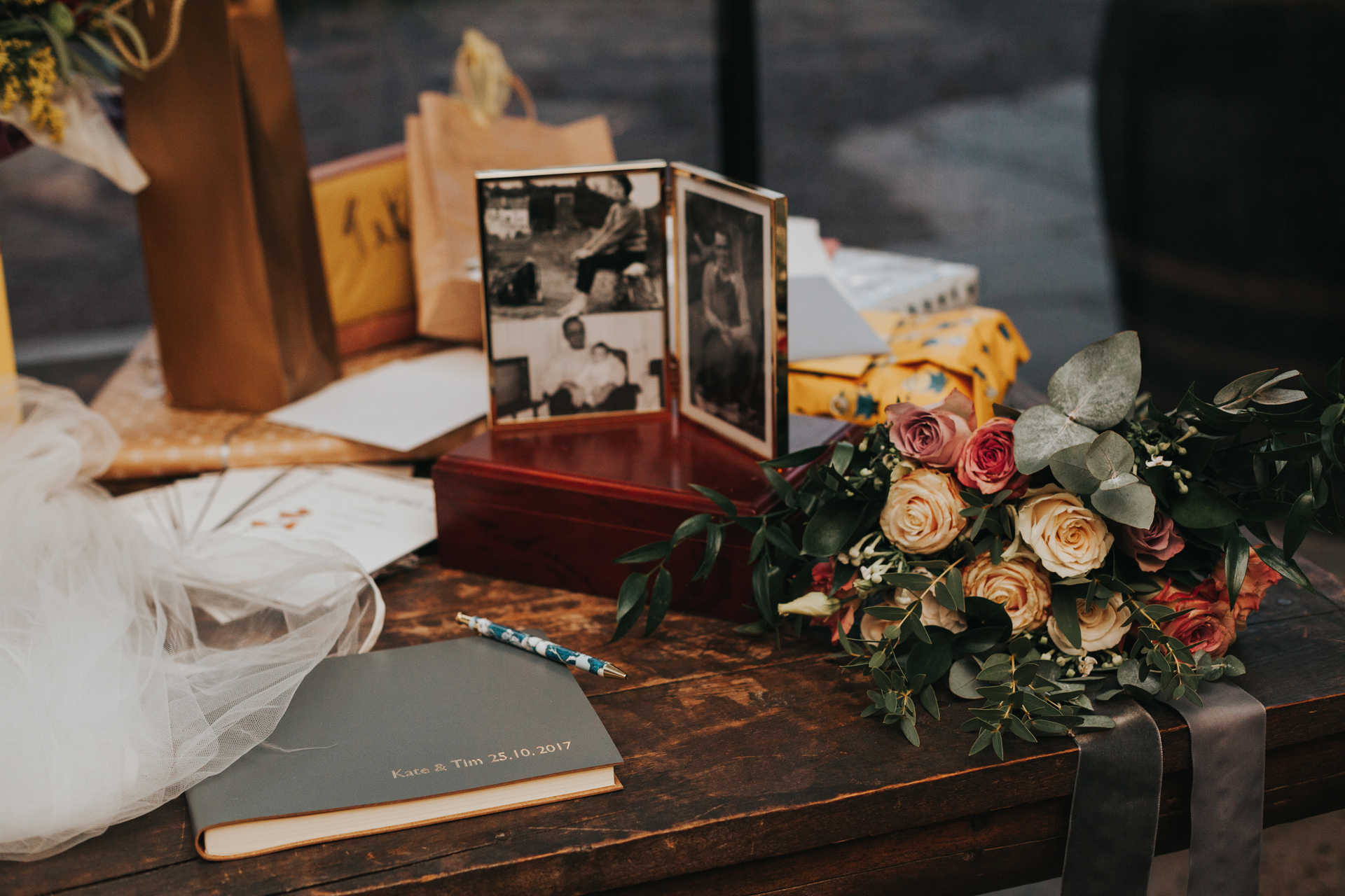 Flowers, veil and guest book.