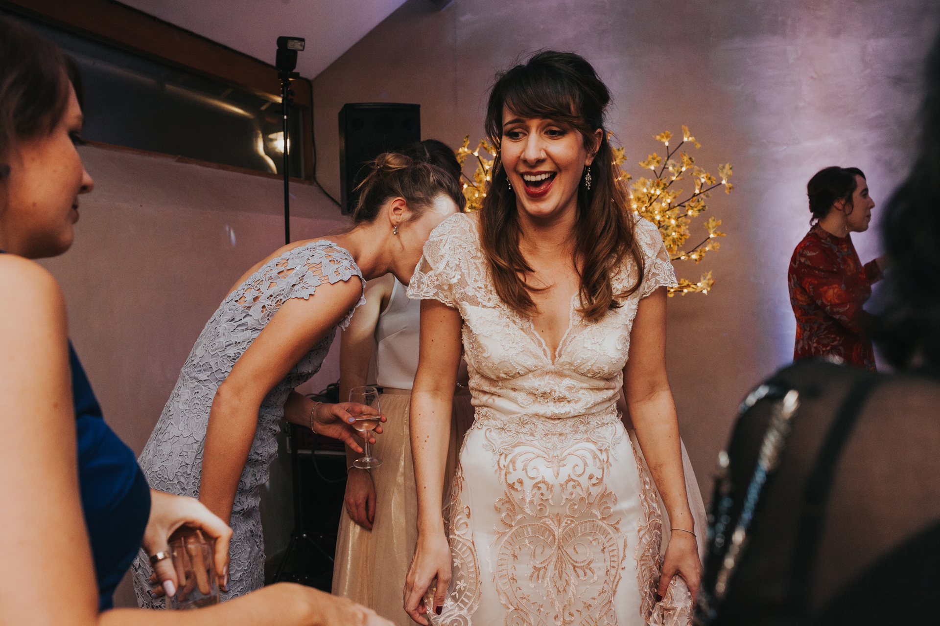 Bride laughing on dance floor.