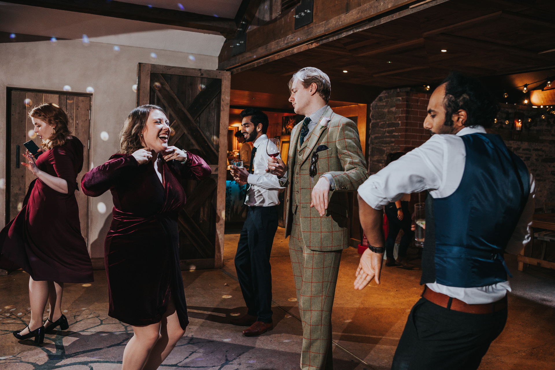 Guests laughing on dance floor.