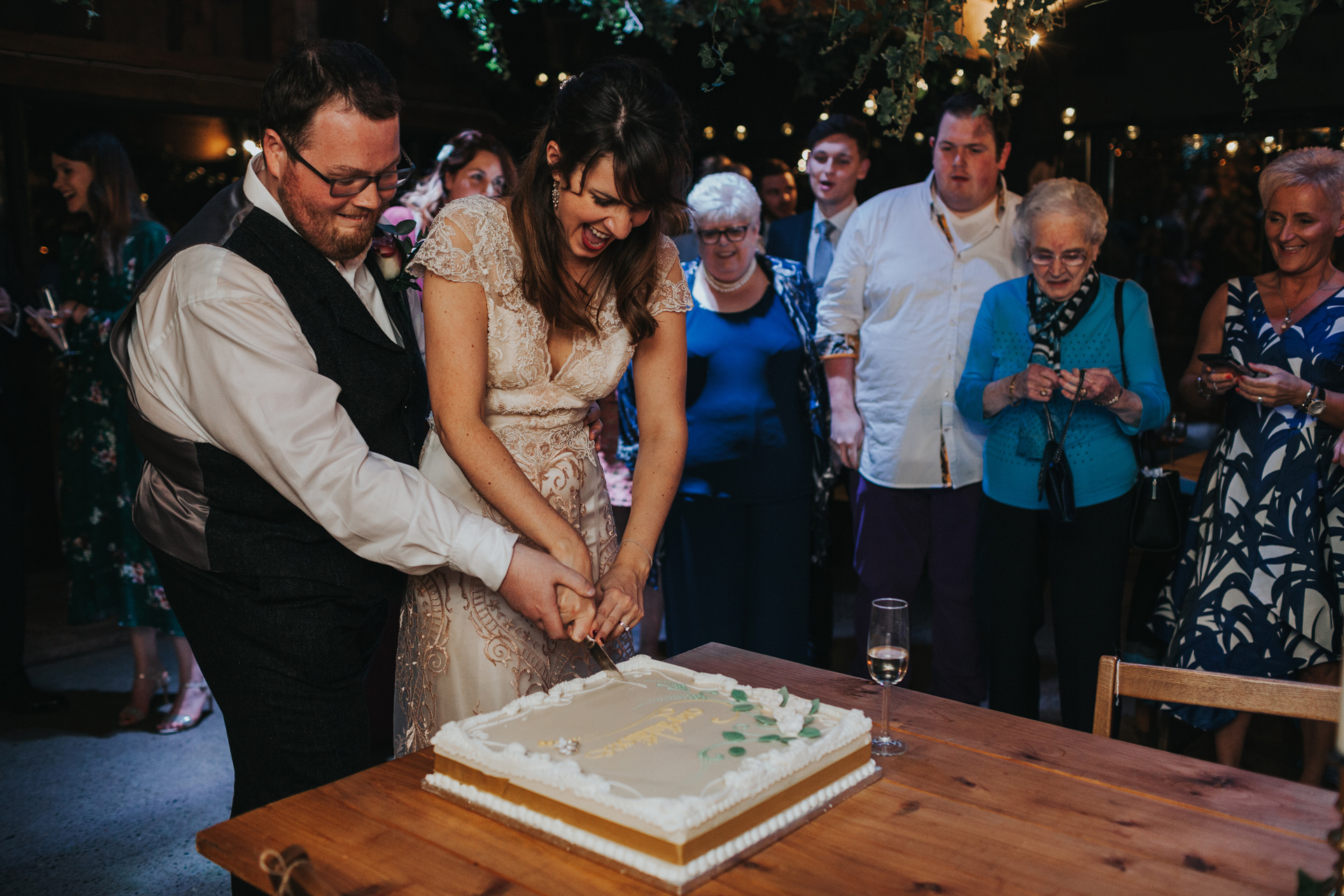 Bride and groom cut cake number two.