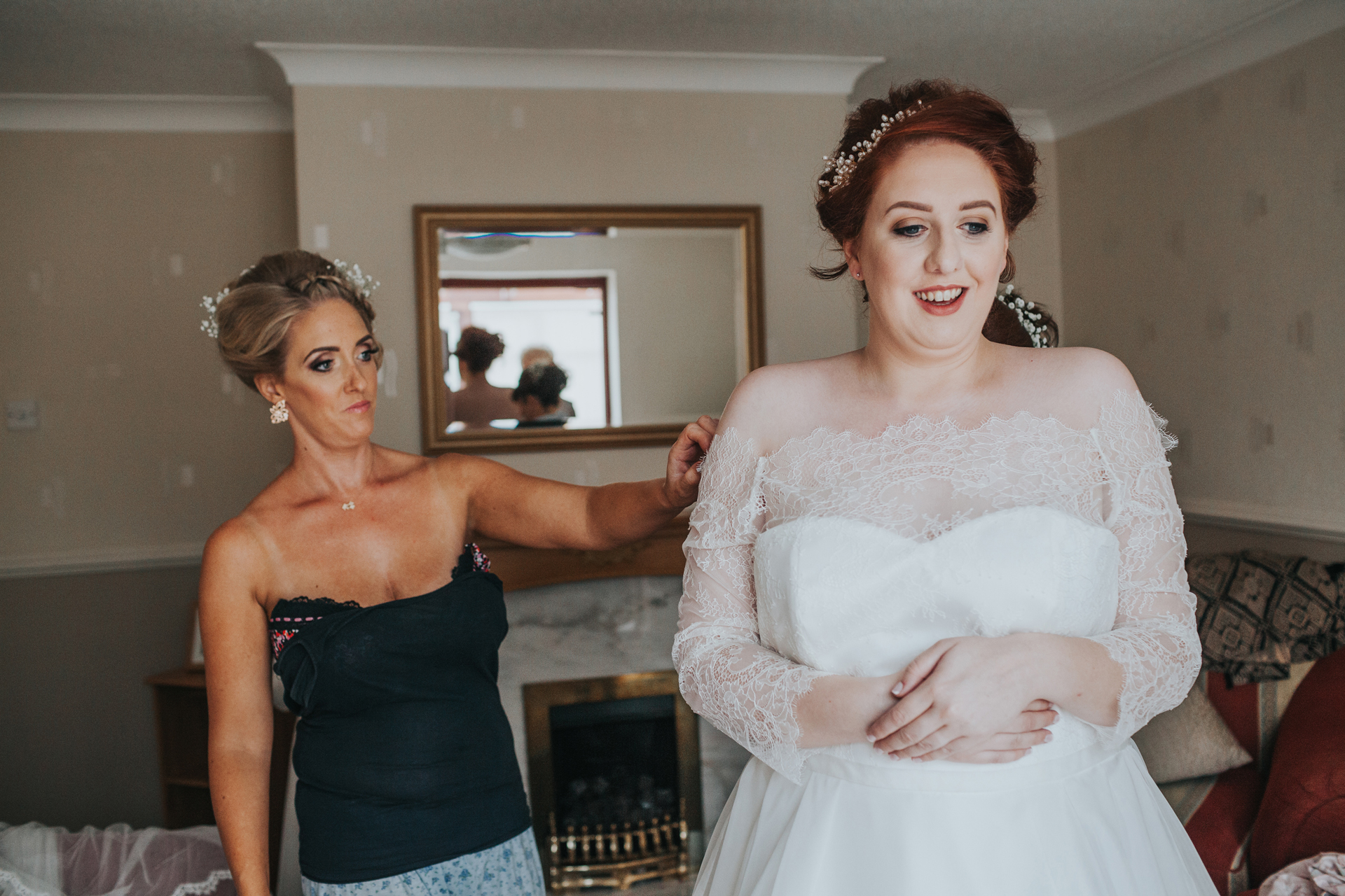 Bride getting her dress on in Liverpool.