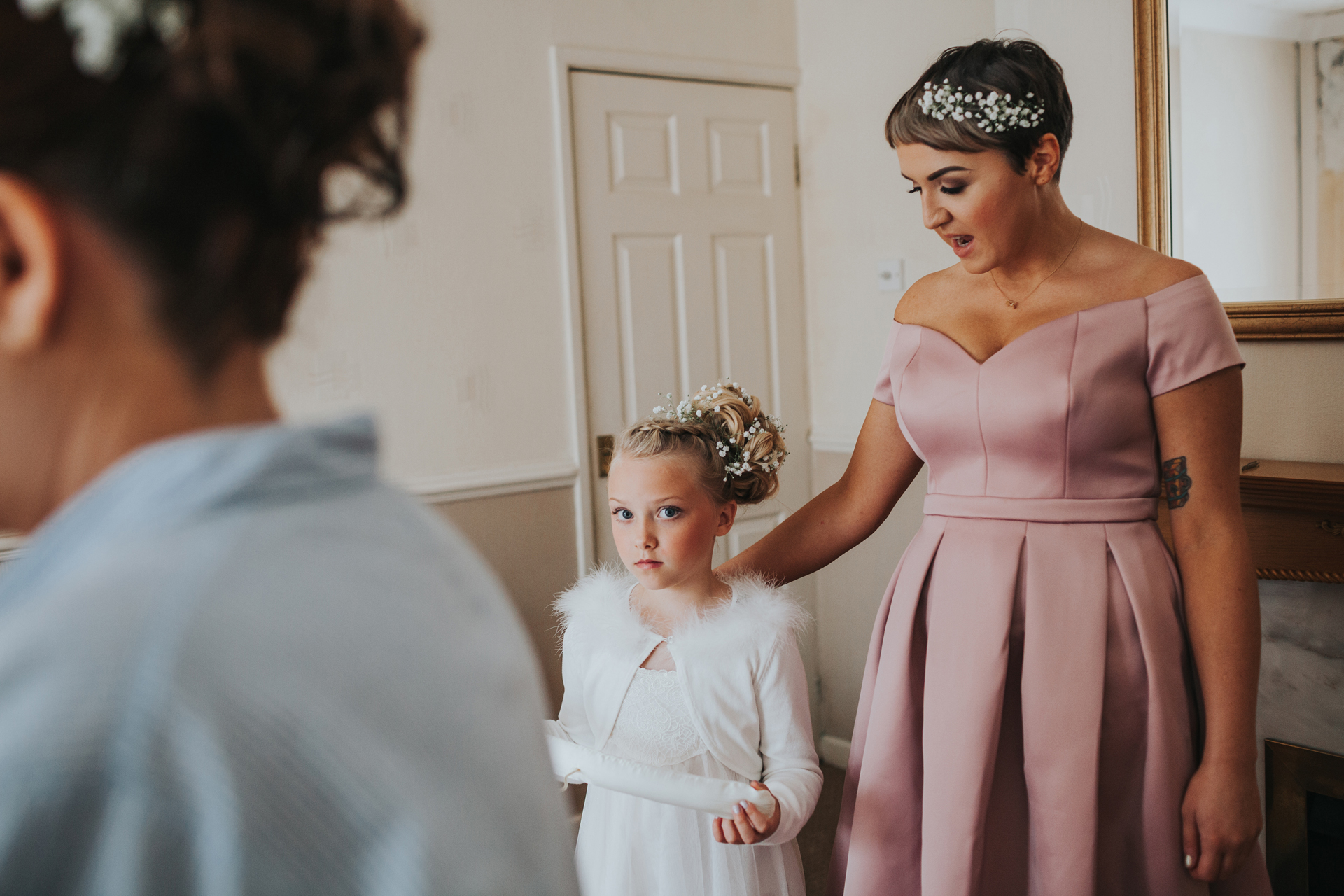 Flower girl watching bride getting ready.