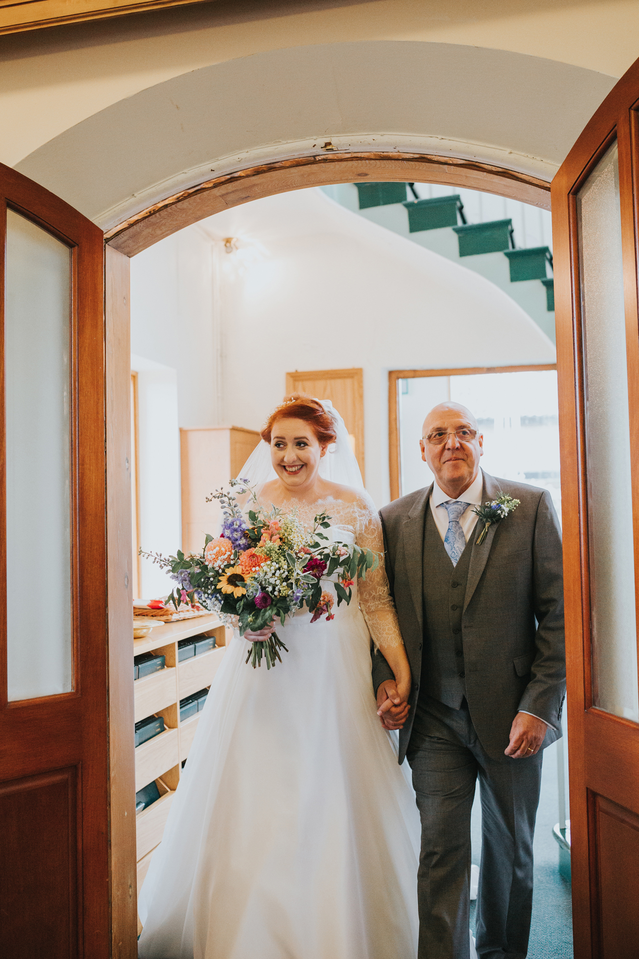 Bride entering the church with her father.