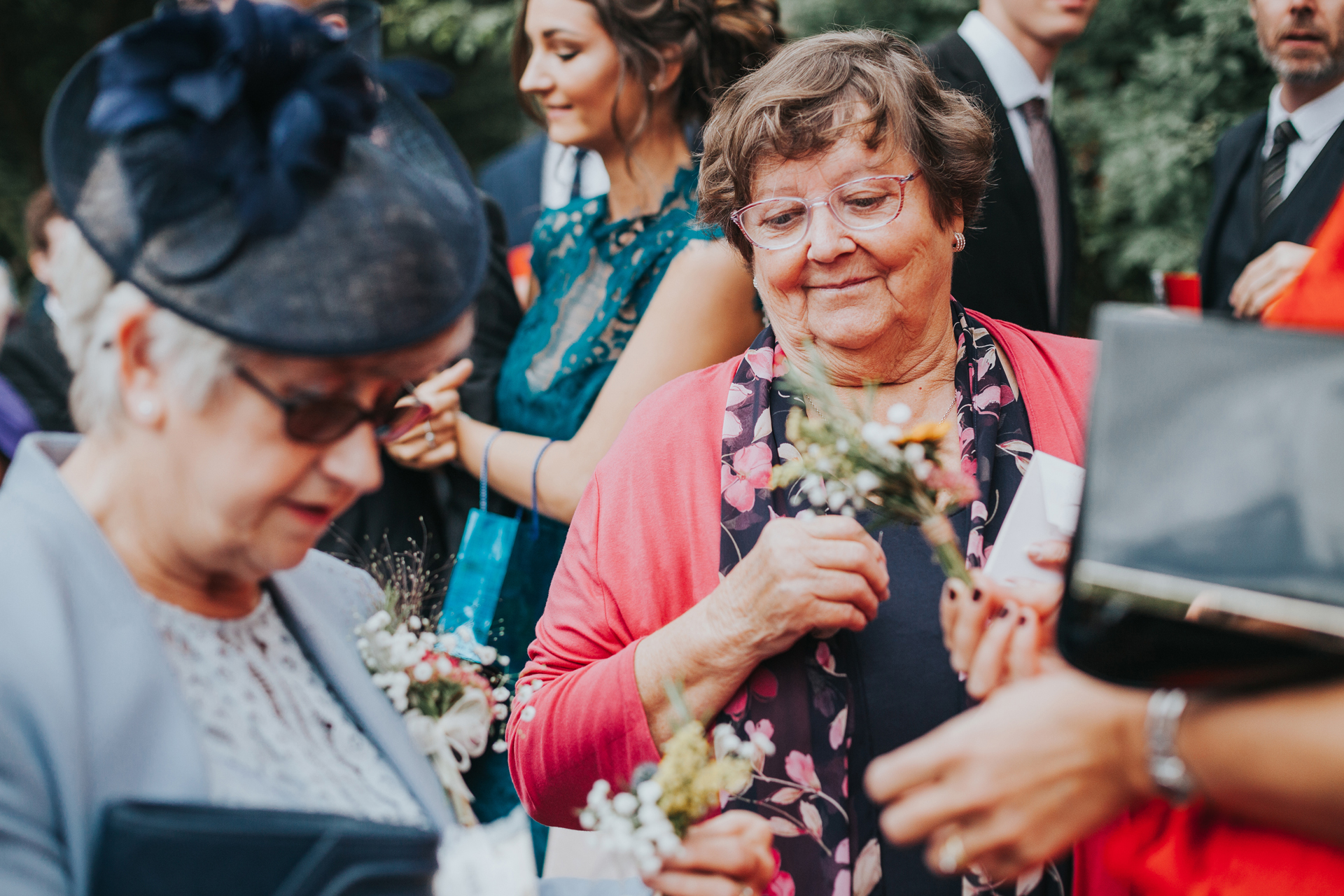 Wedding guests sort out the confetti.