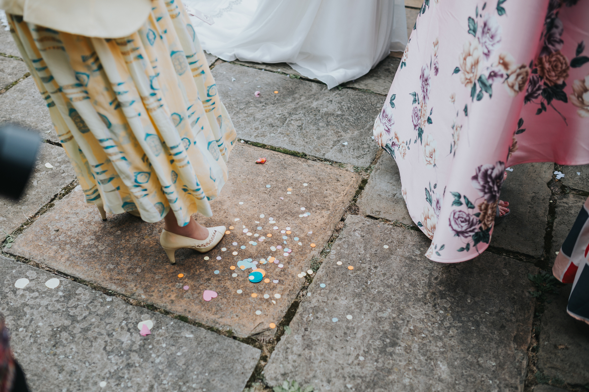 Brightly coloured confetti spilt on the floor.