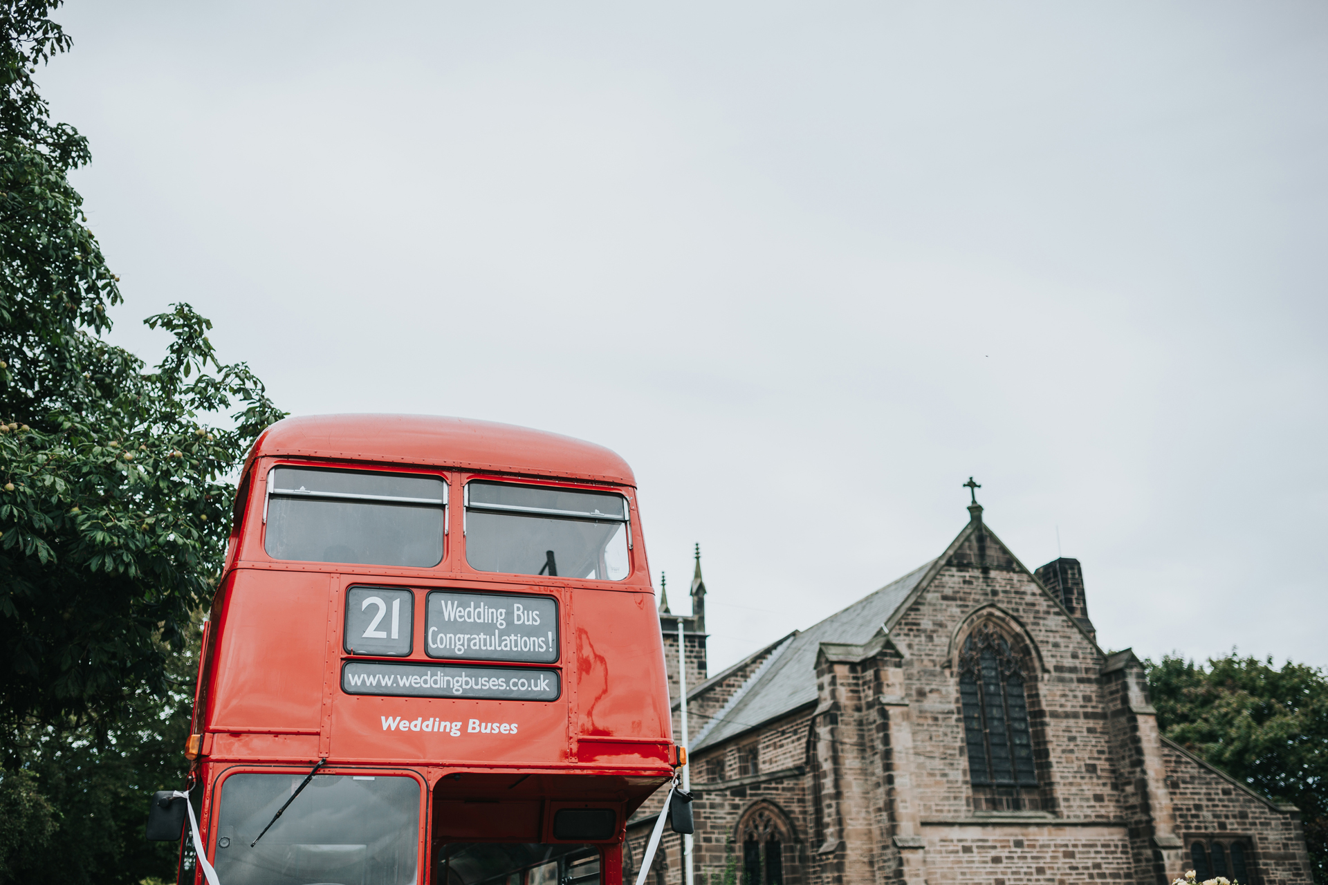 Front of the wedding bus parked next to the church.