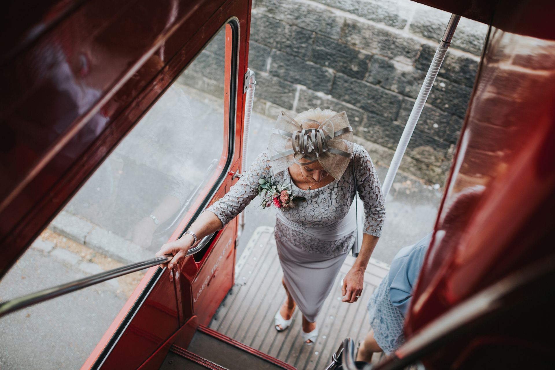 Mother of the bride steps onto the wedding bus.