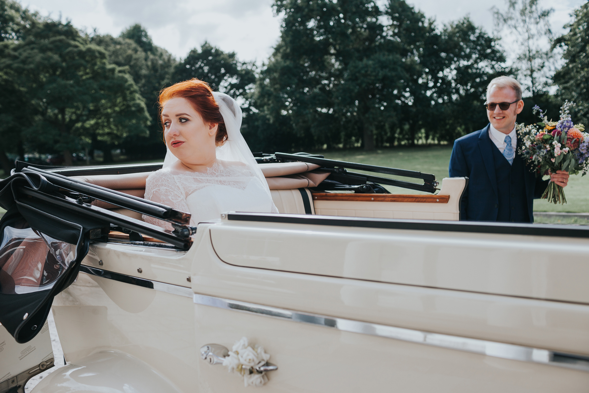 Bride and groom arrive at Trafford hall in their wedding car.