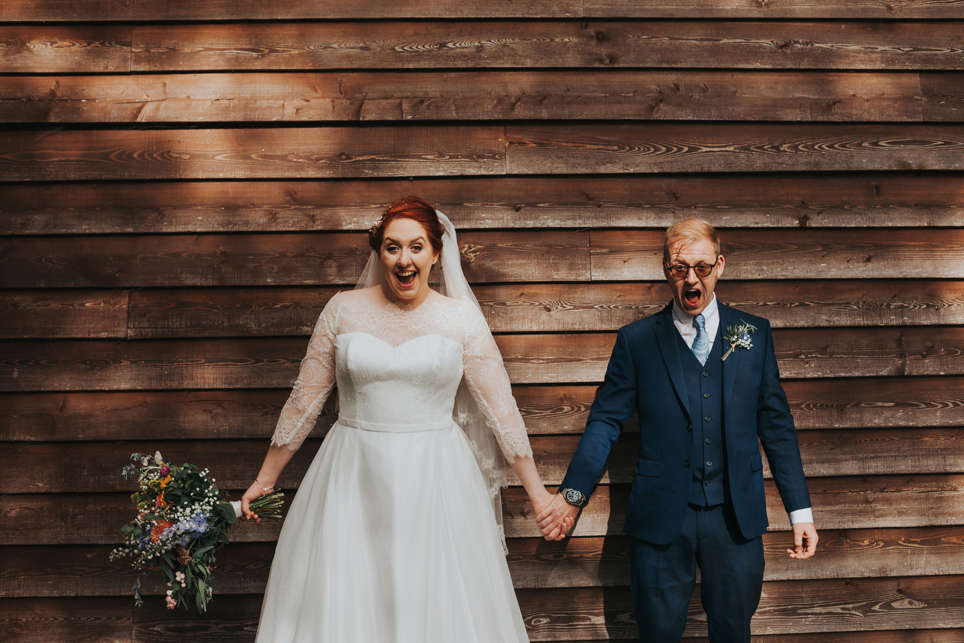 Bride and Groom have excited faces at Trafford Hall Wedding.
