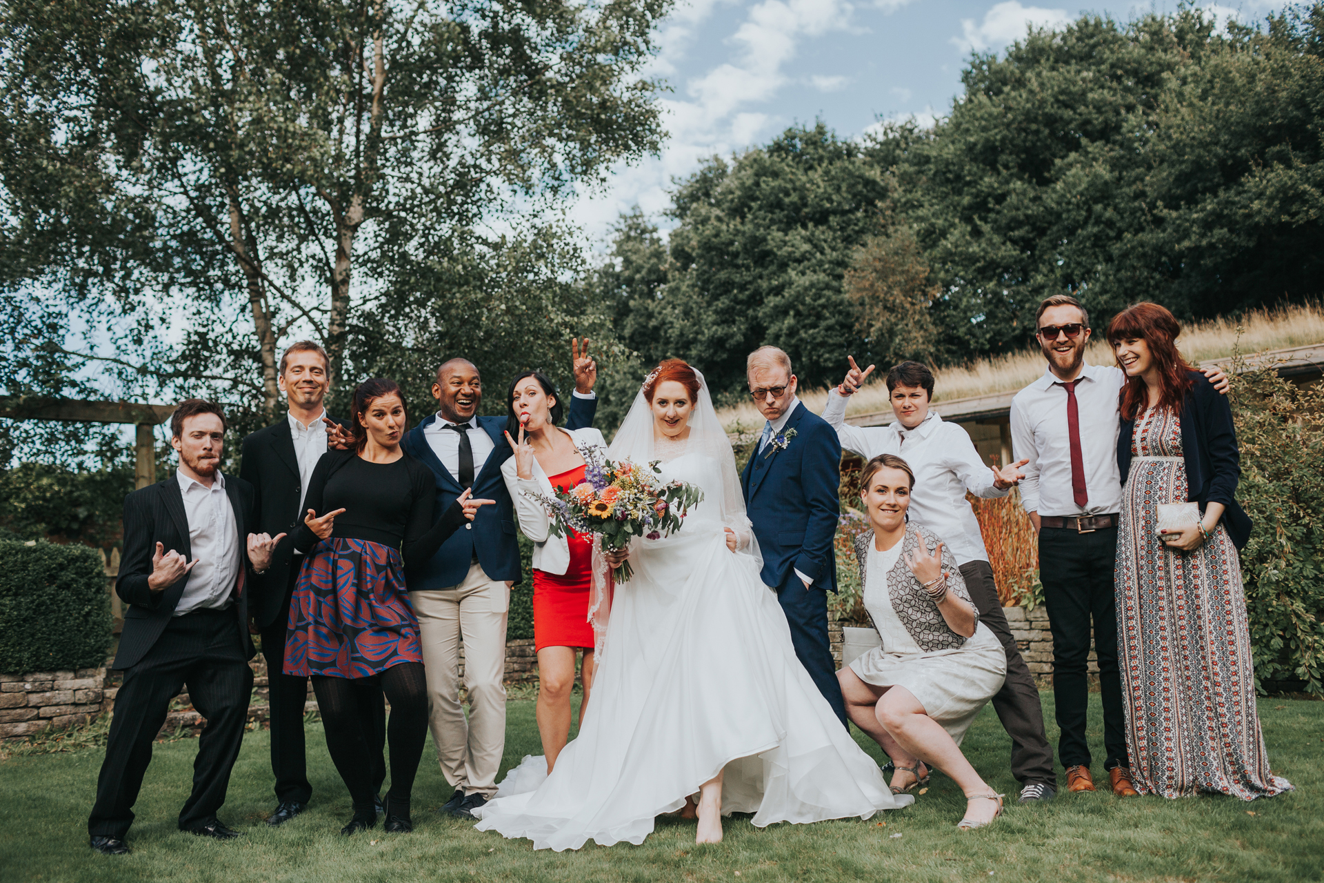 Bride and Groom posing with their mates.