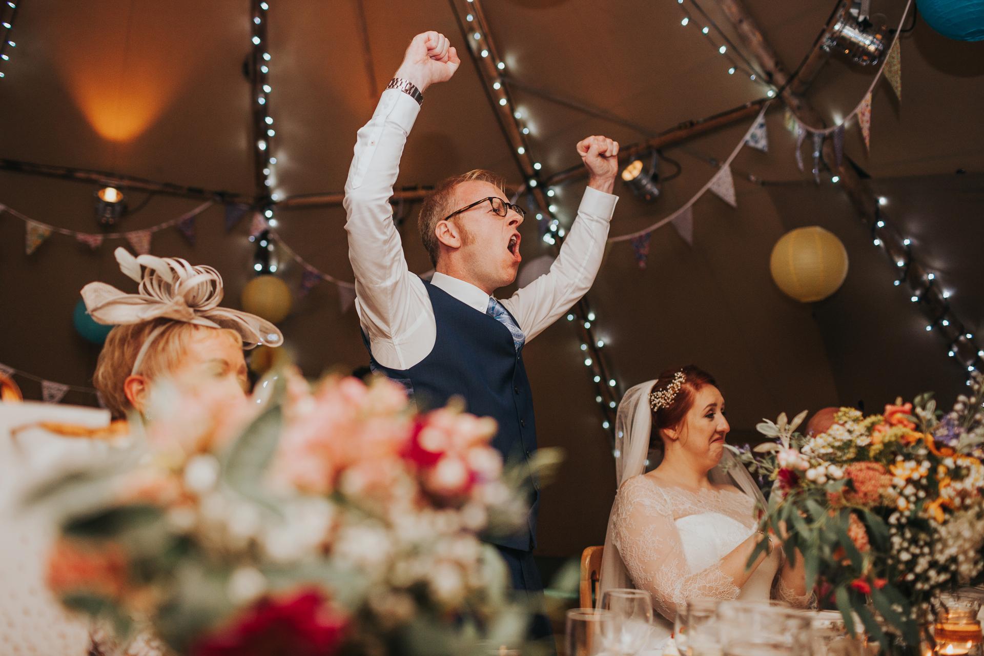 The groom cheering.