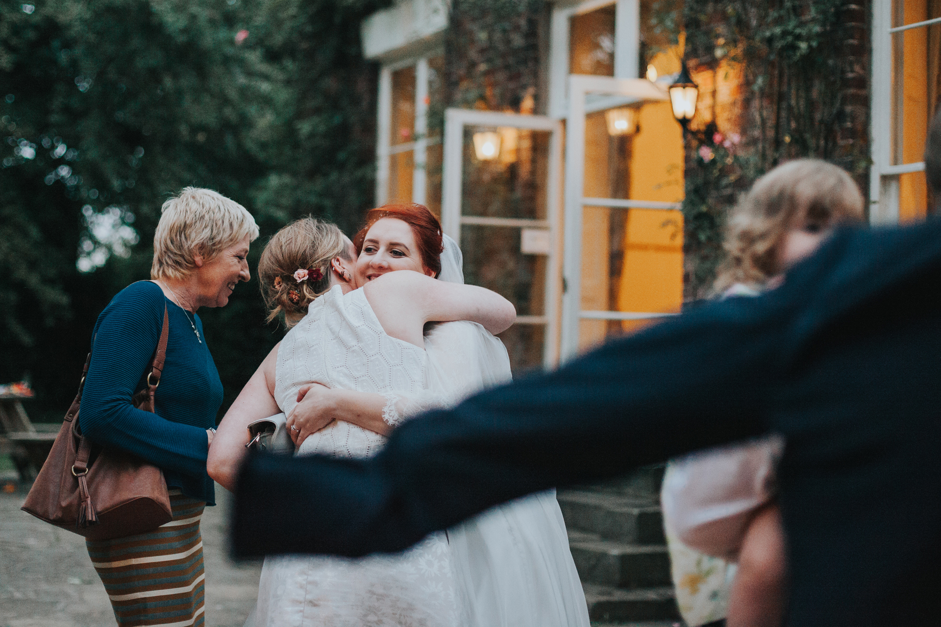 Bride hugging a guest outside the tipi.
