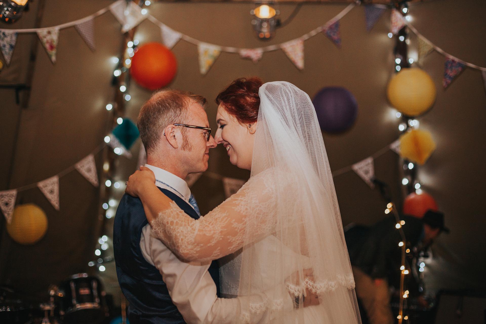Bride and groom begin first dance.