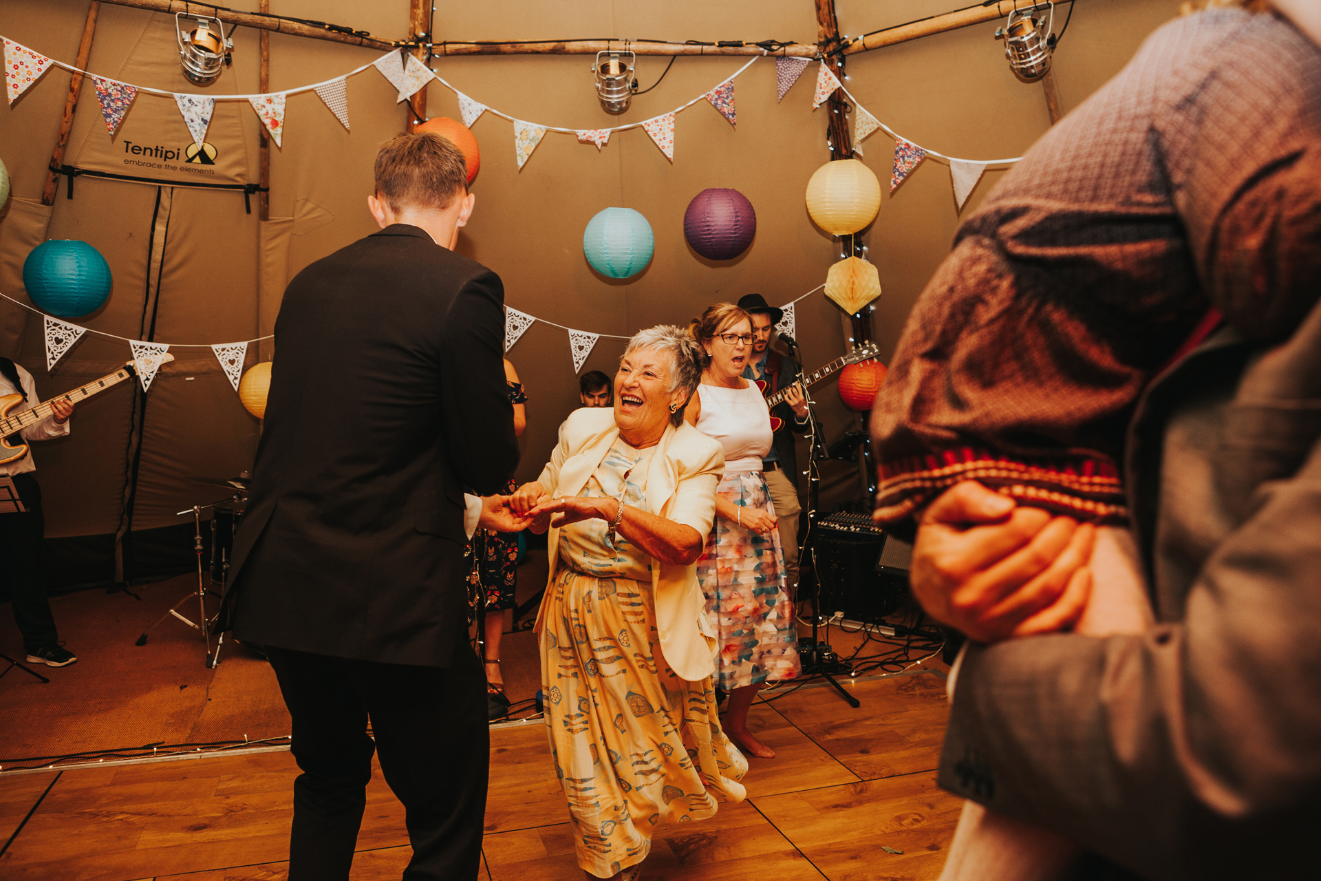 Guests dancing in tipi.