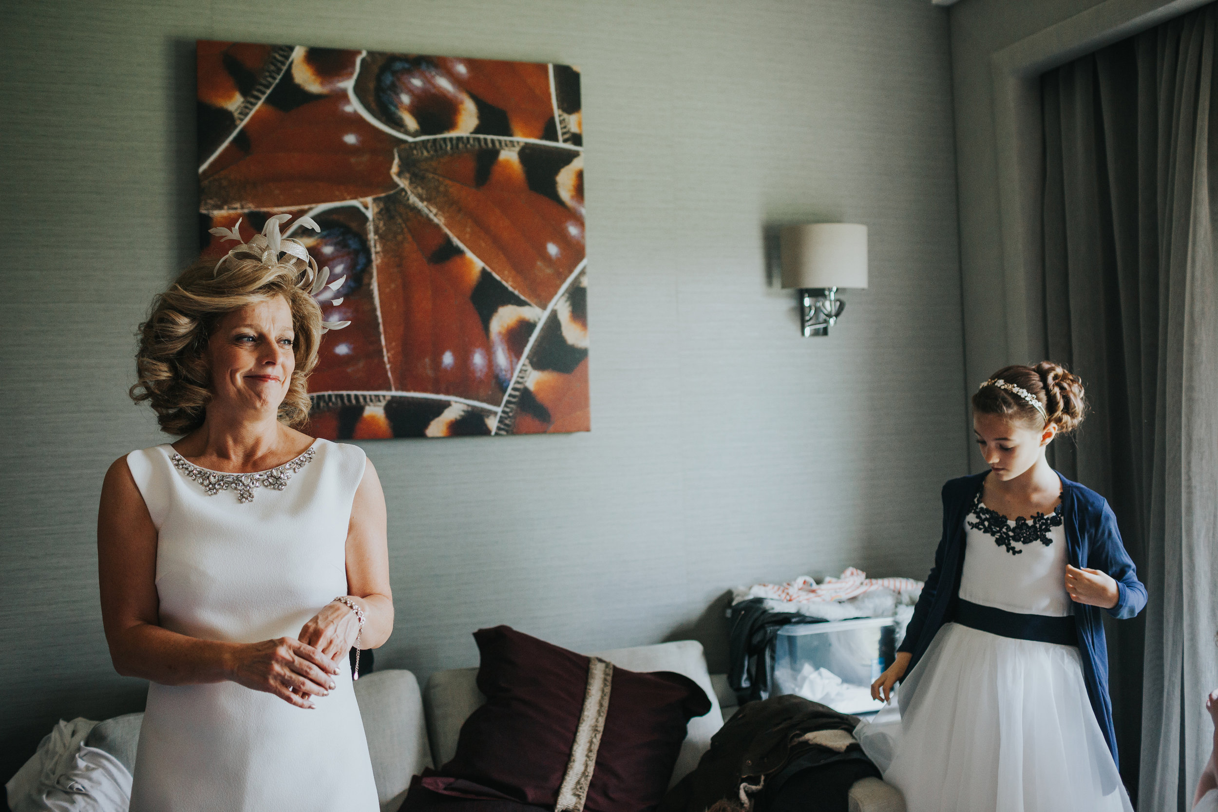 Mother of the bride watches her daughter getting ready.