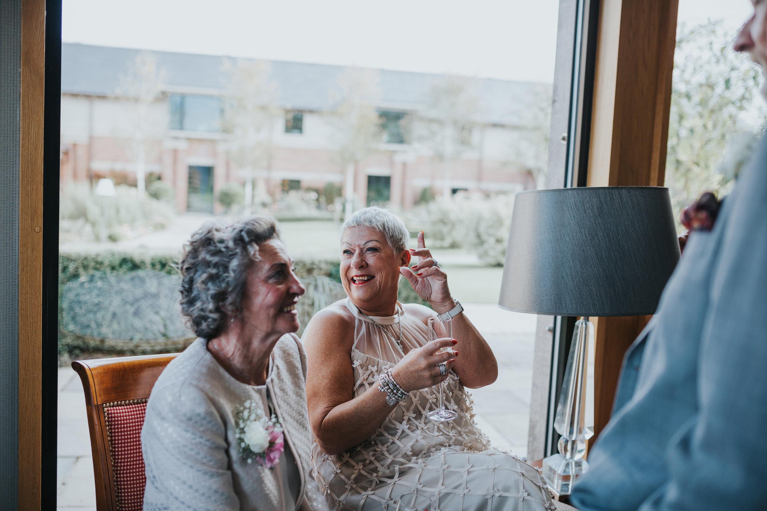 Wedding guest laughs.