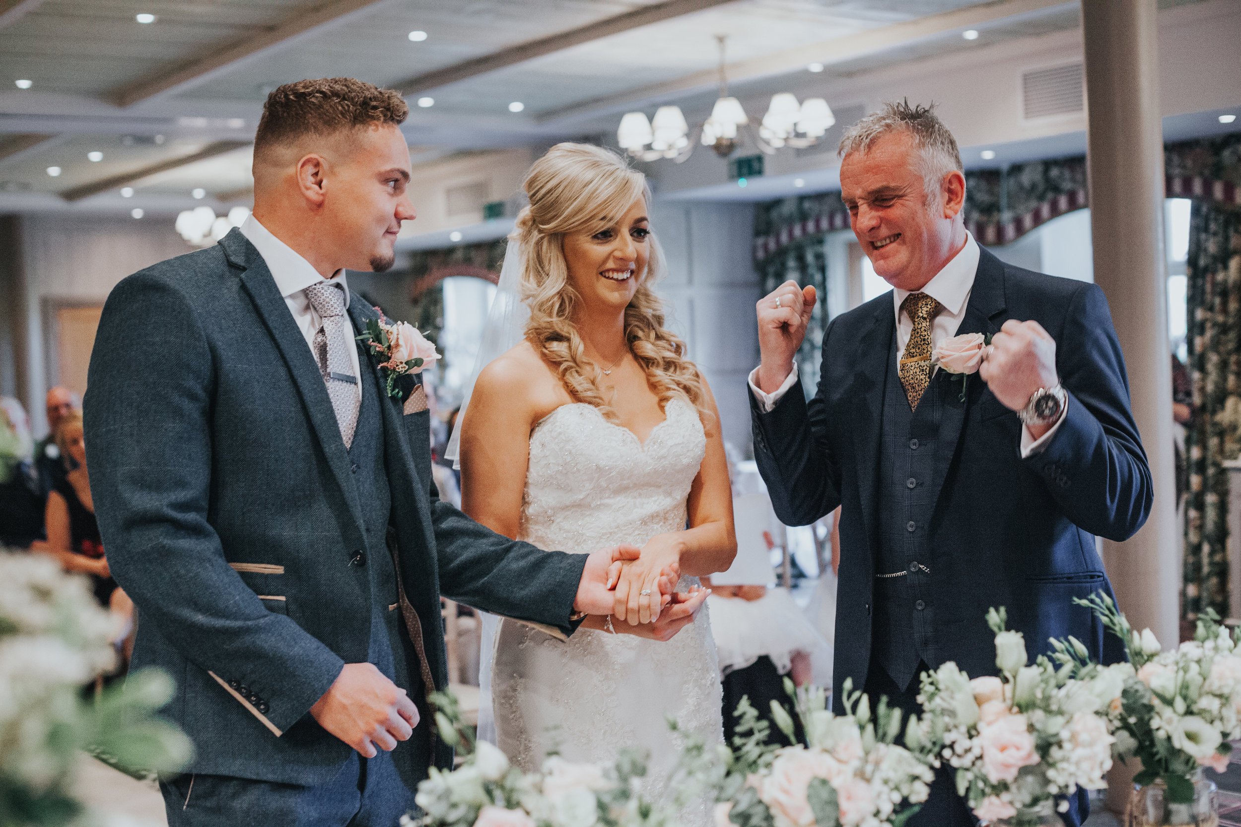 Father of the bride looks very excited about giving his daughter away...