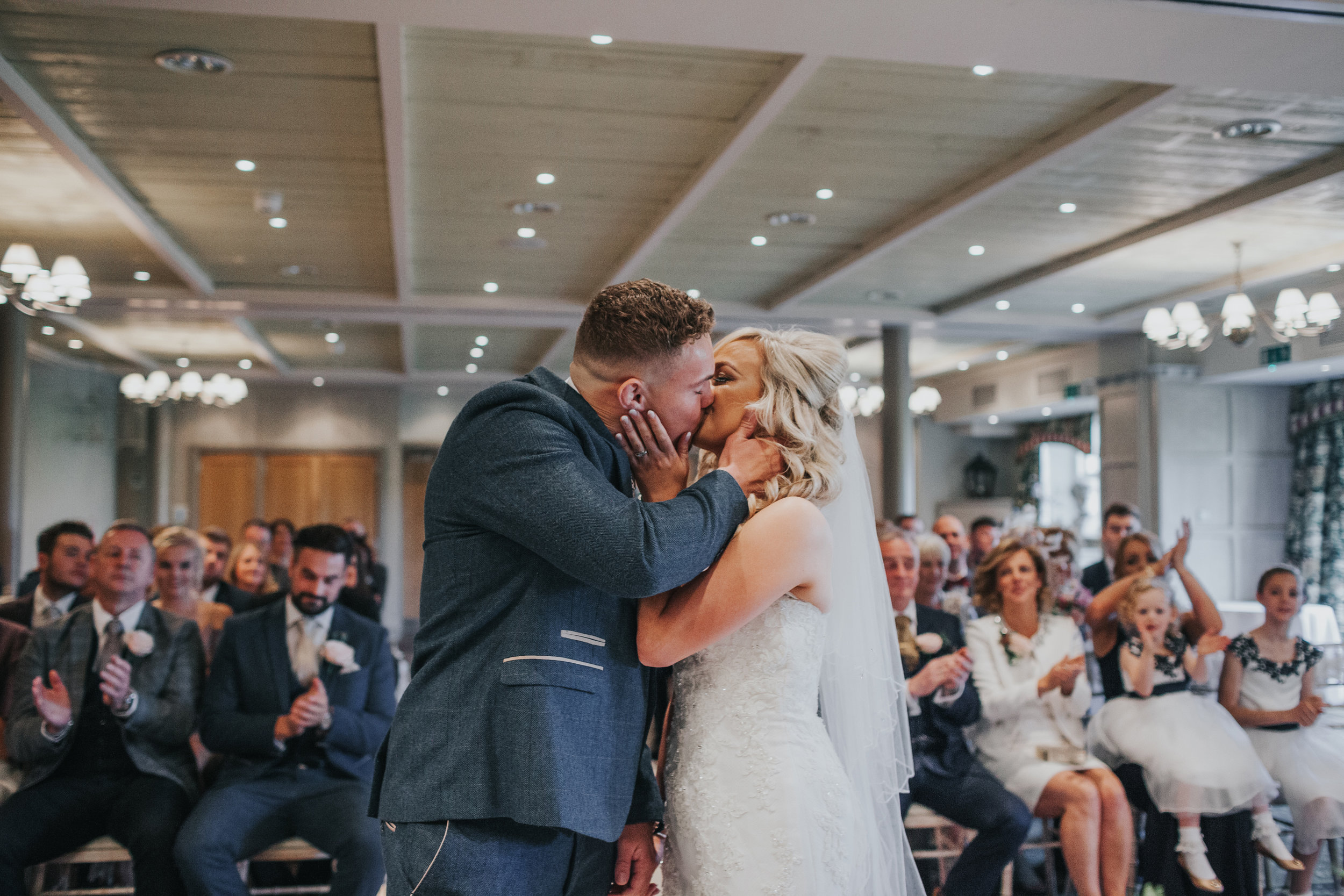 Bride and groom kiss on their wedding day.