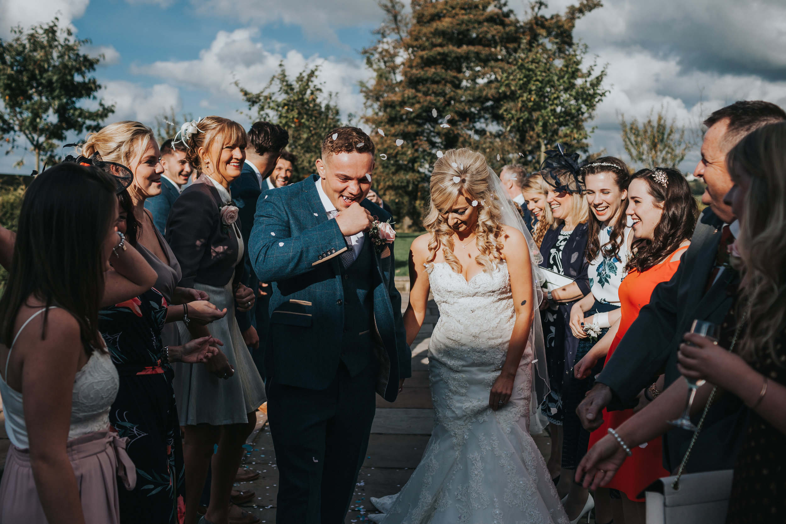 Groom gets confetti in his mouth.
