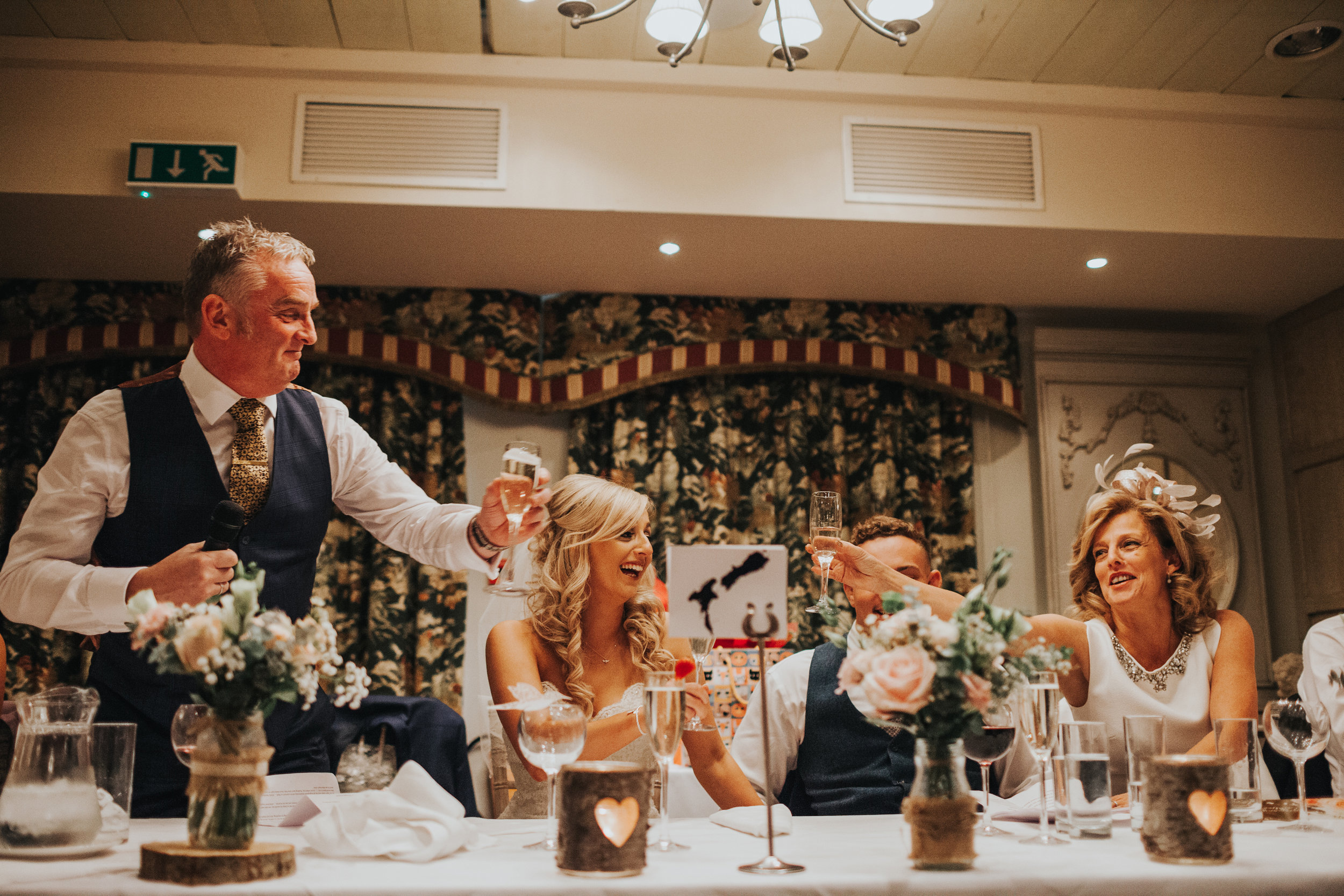 Father or the bride makes a toast.