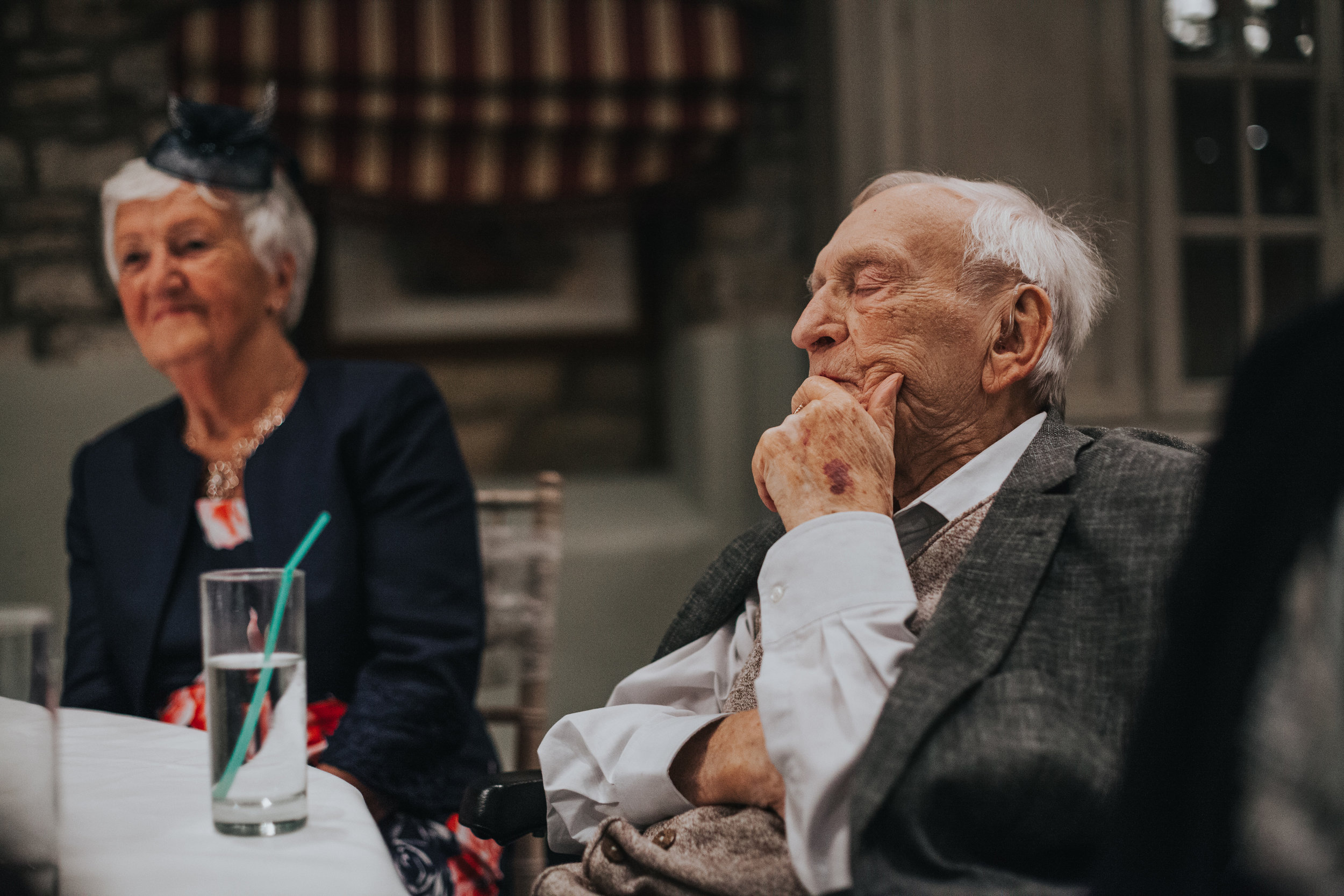 Grandad is having a sneaky sleep during the speeches.