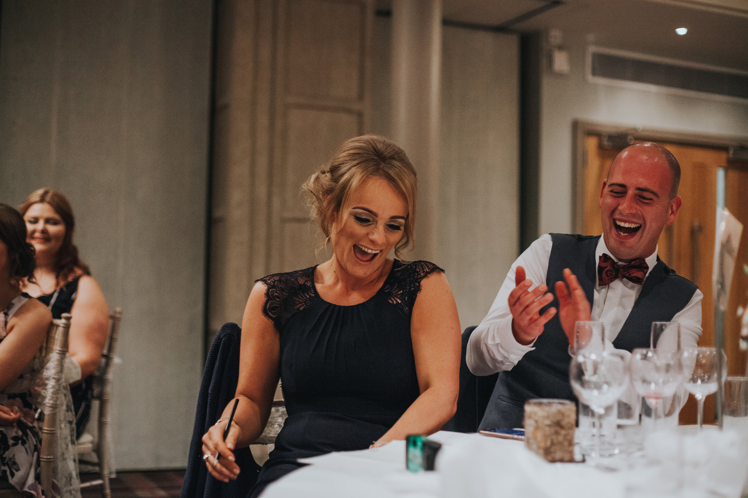 Couple laughing at speeches.