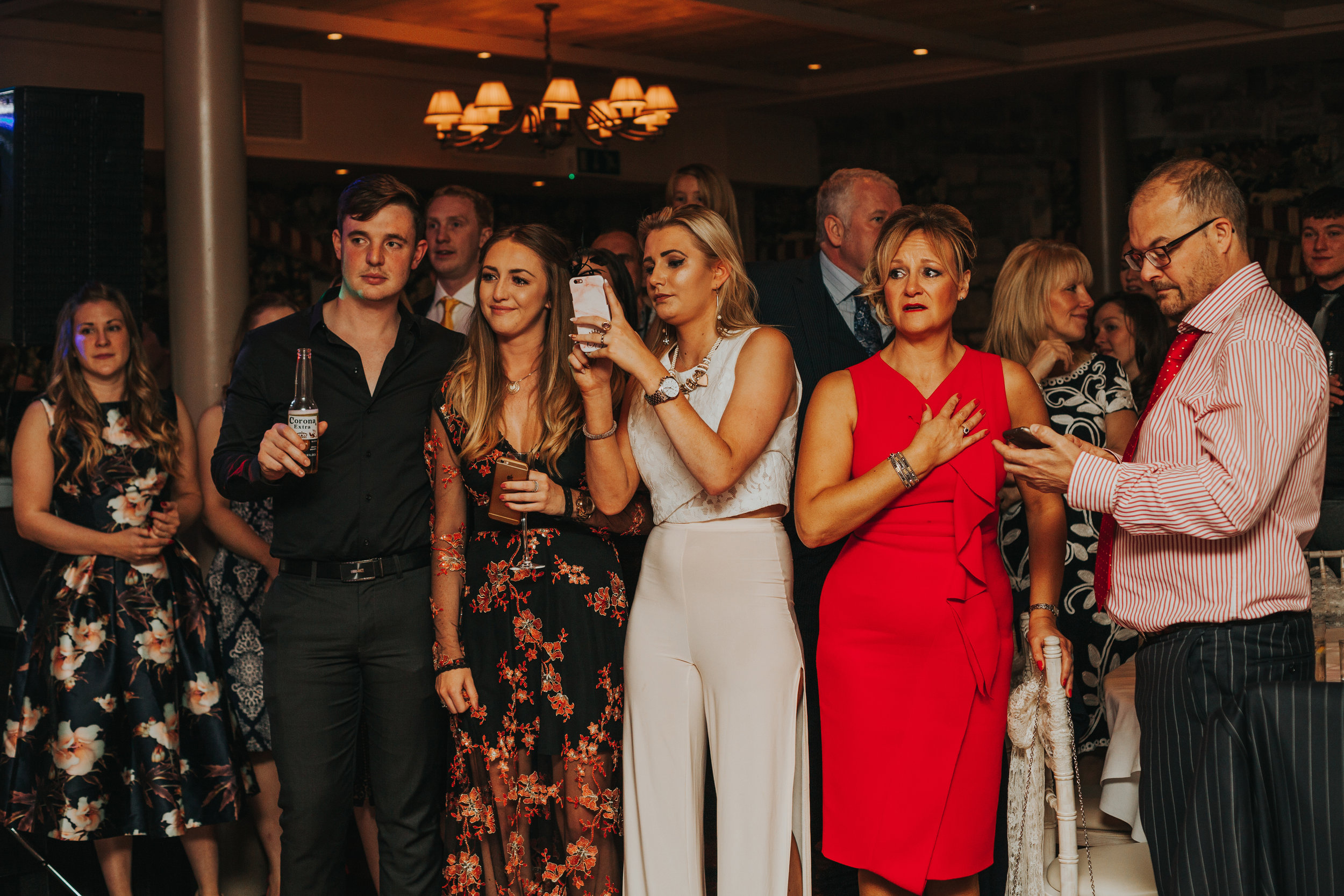 Wedding guests watch the dance getting emotional.