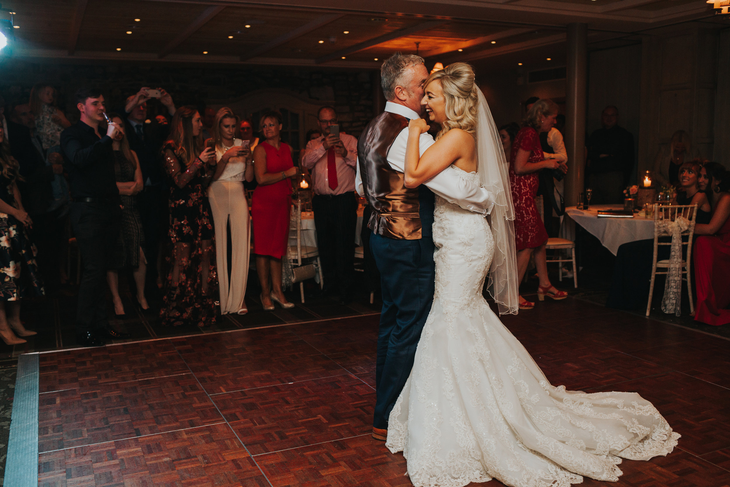 Bride begins to cry while dancing with her Dad.