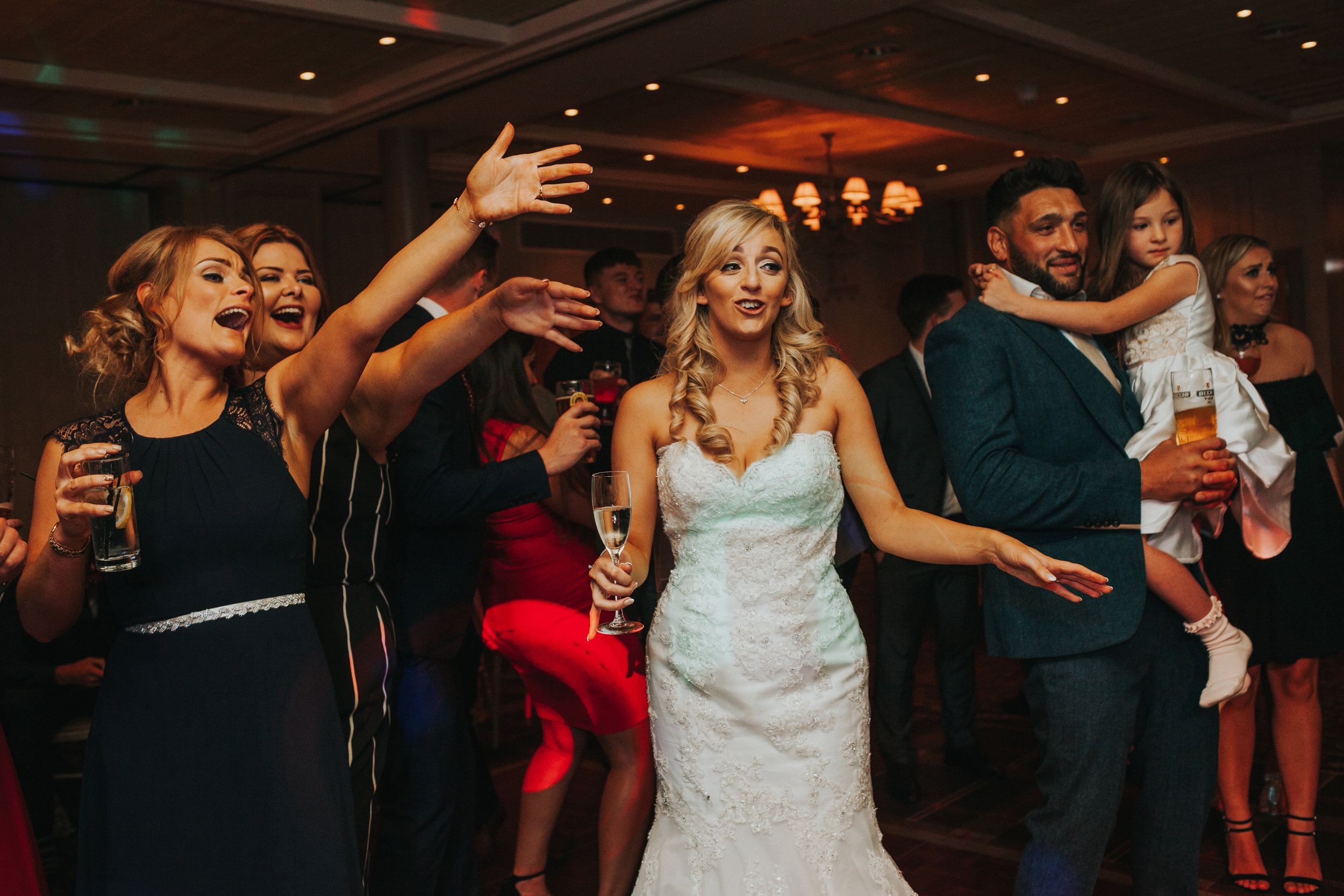 Bride dancing with guests.