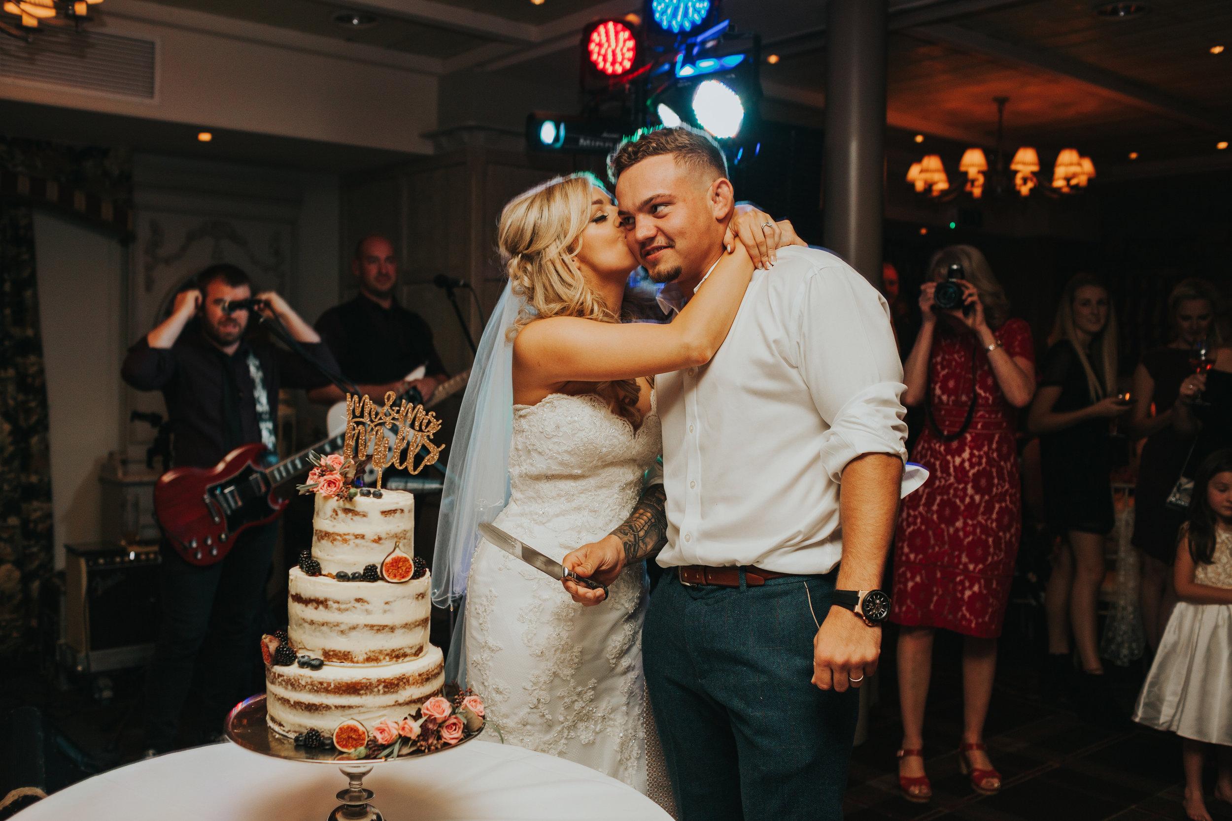 Bride kisses groom.