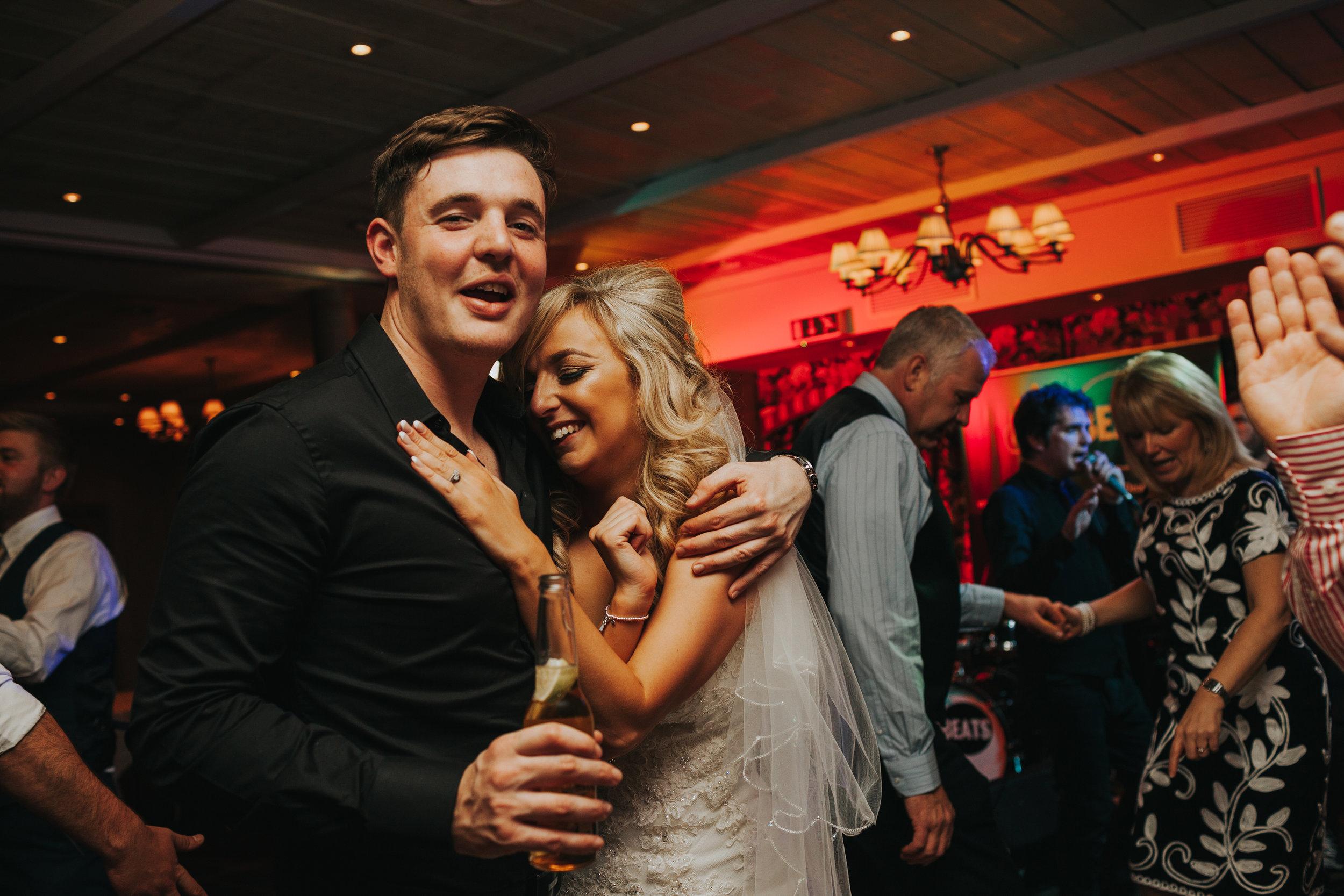 Bride hugs friend on dance floor of Stanley House.
