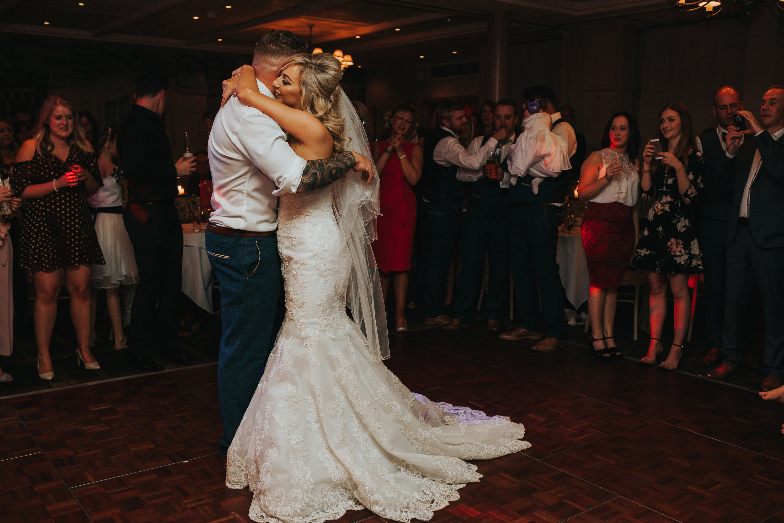 Bride and groom dance together alone.