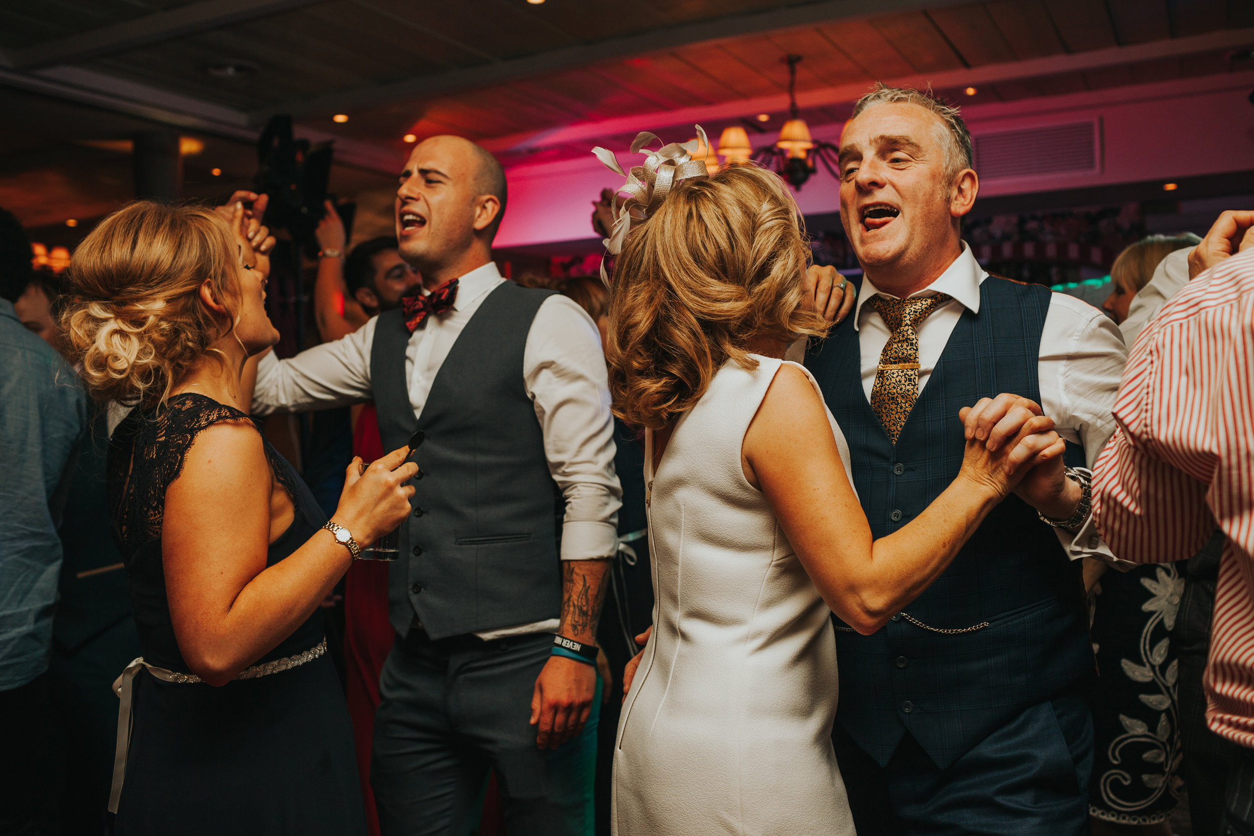 Parents of the bride dance together.