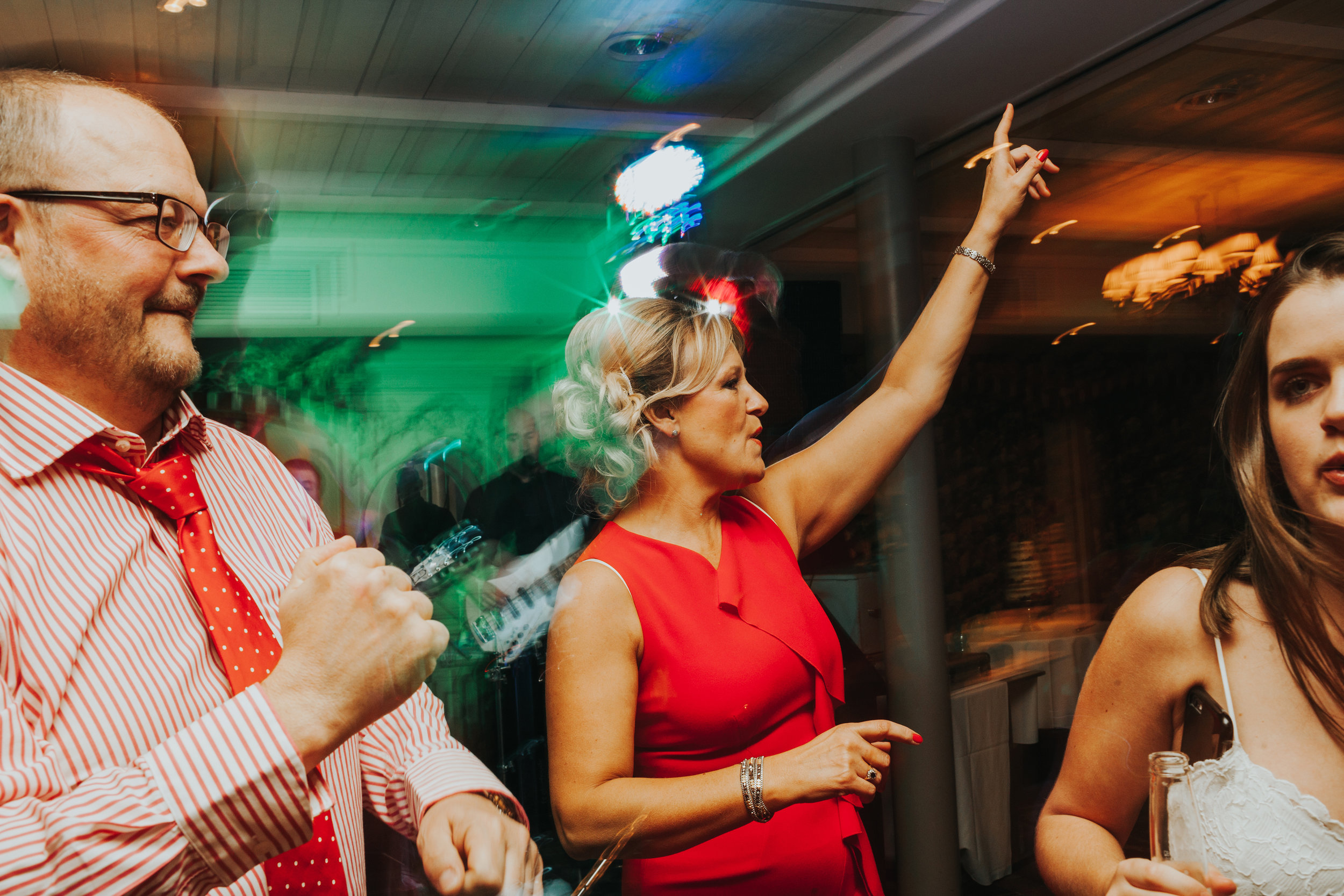 Guests dancing, slow shutter speed effect.