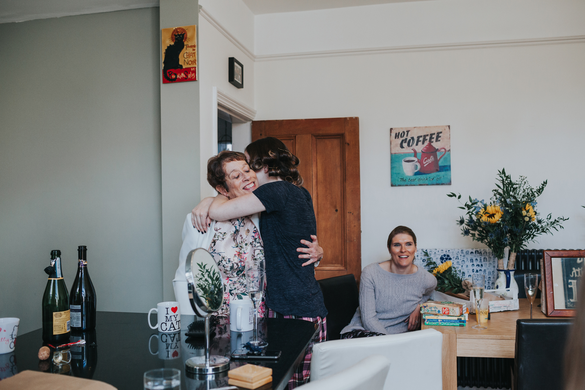 Mum and Bride have a hug in the kitchen on the morning of her wedding day.