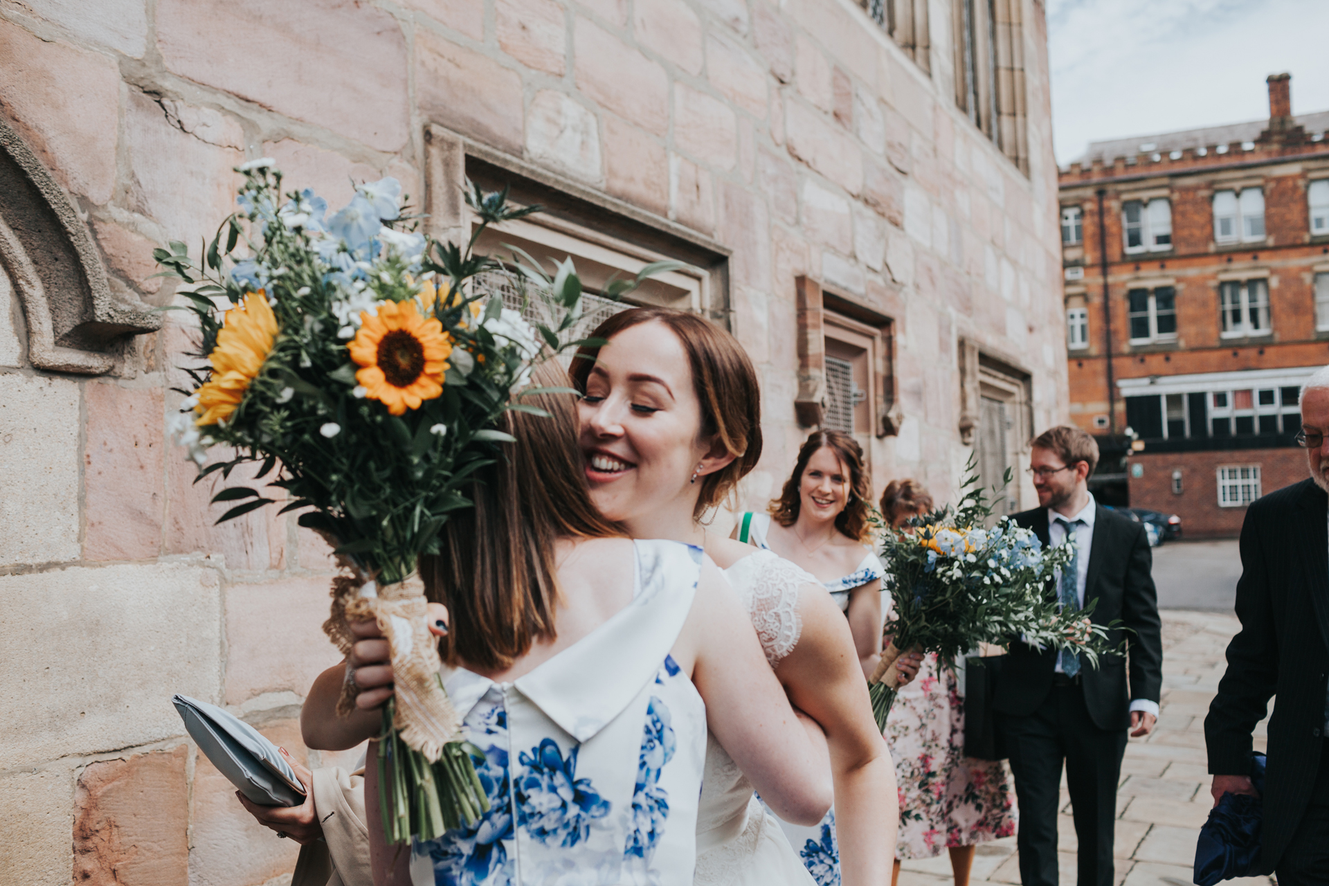 Bride arrives at Chetham's Library Manchester.