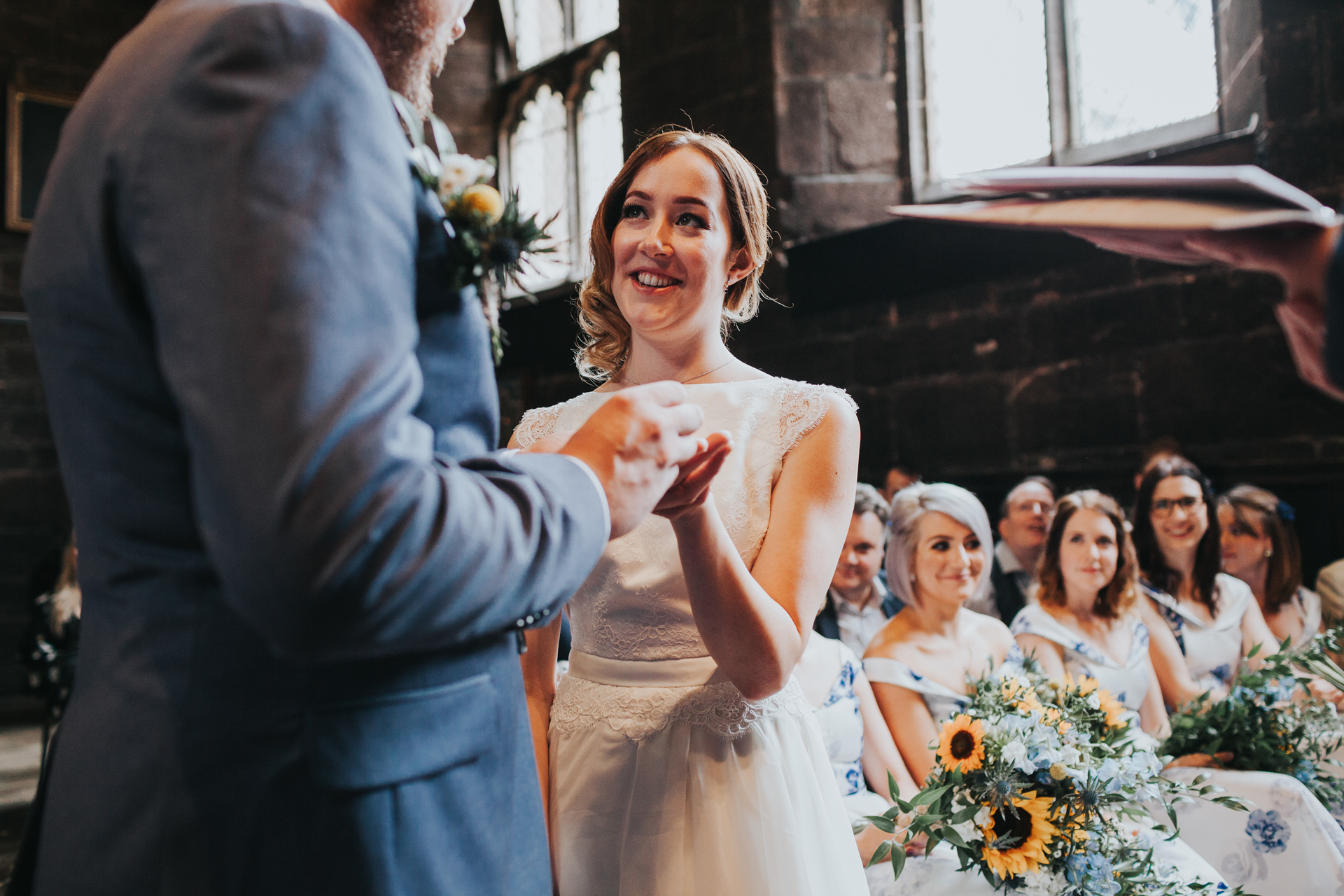 Bride takes her ring at Chetham Library Manchester.