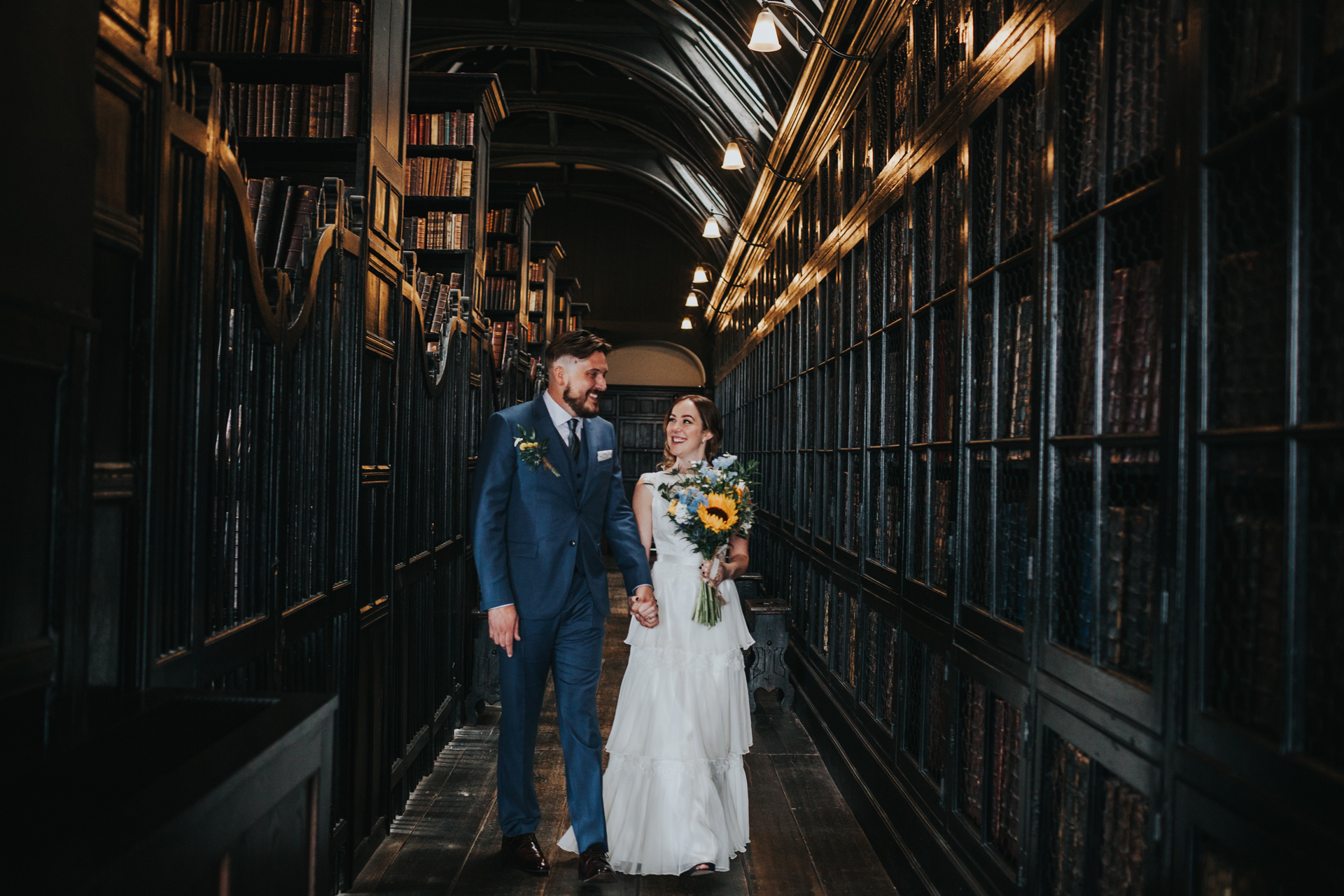 Bride and Groom walk through Chetham Library together.