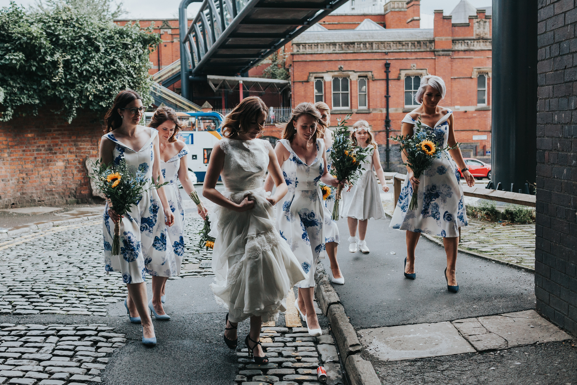 Bridesmaids walk together outside Lock 91.