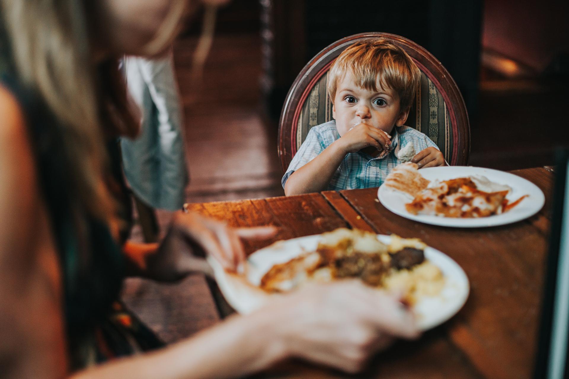 Little boy eats his dinner.