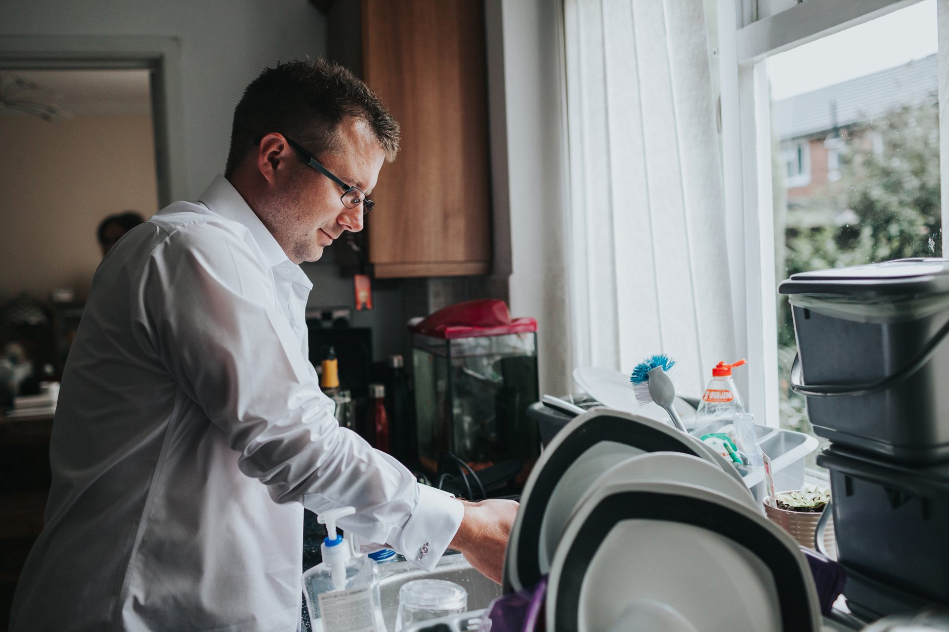 Best man doing the dishes.