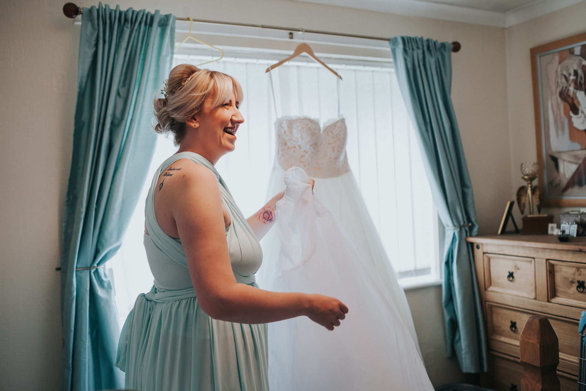 Bridesmaid laughs.