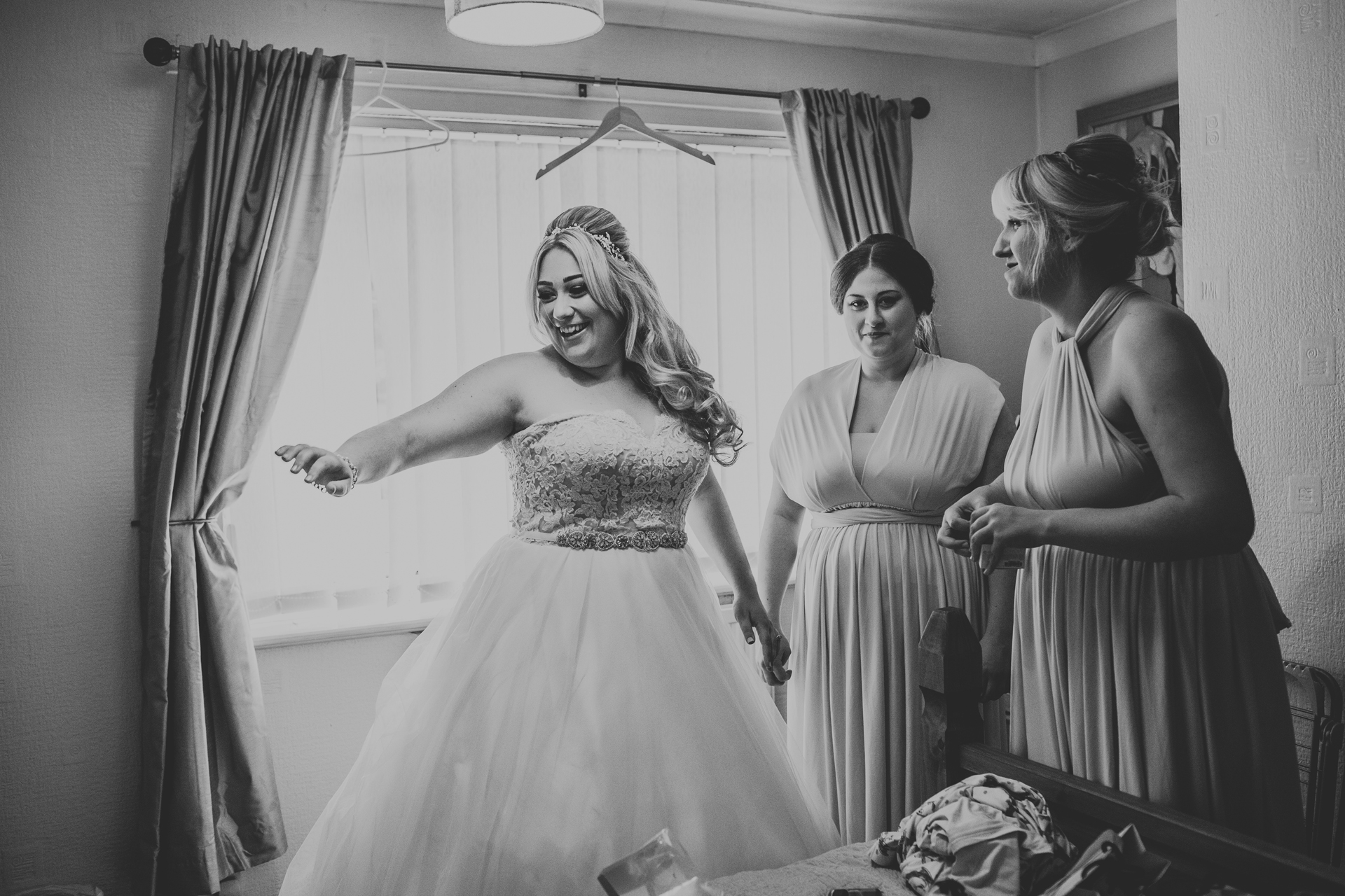 Bride and Bridesmaids laugh together.