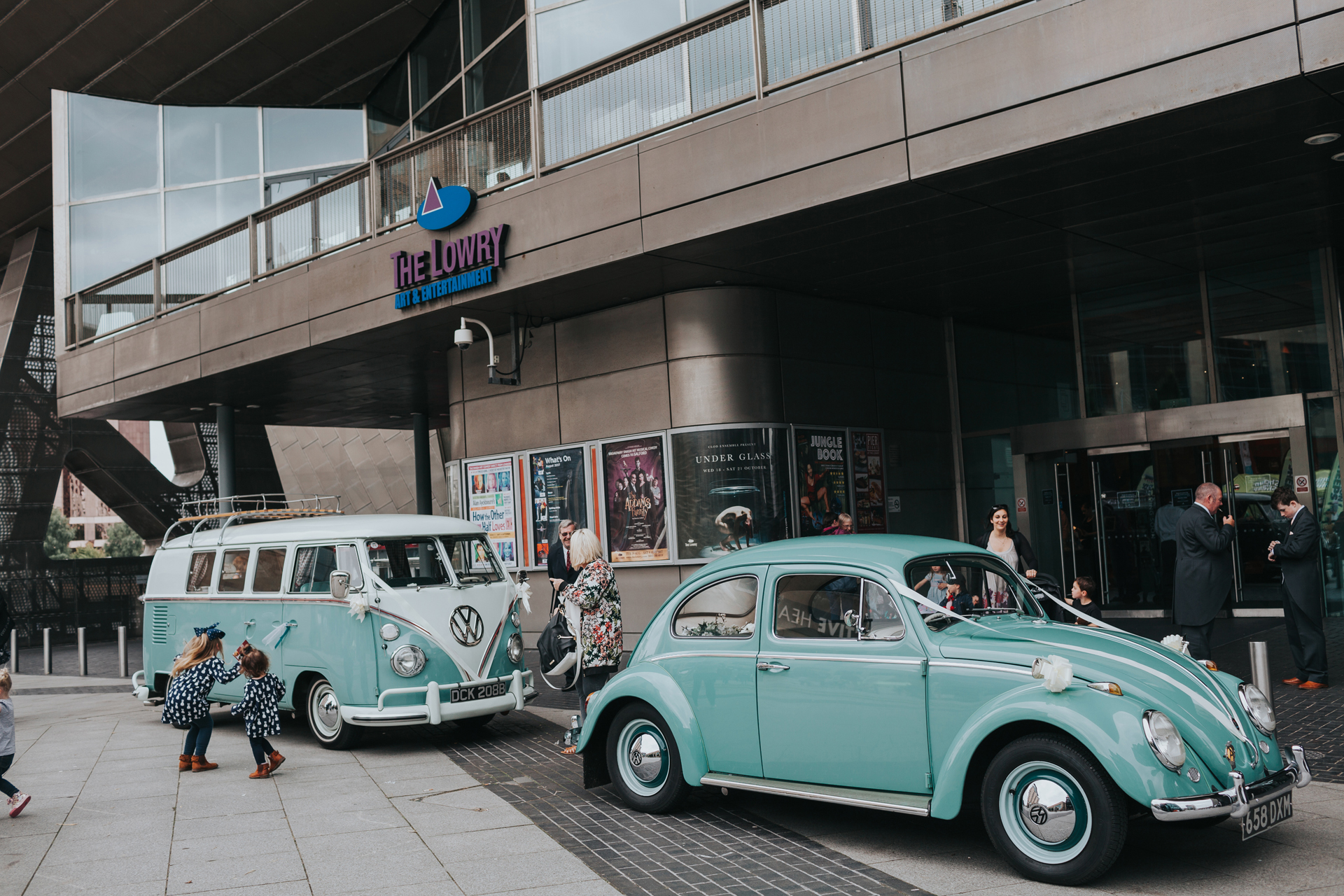 Teal Vintage Wedding Cars arrive at Lowry Theatre.
