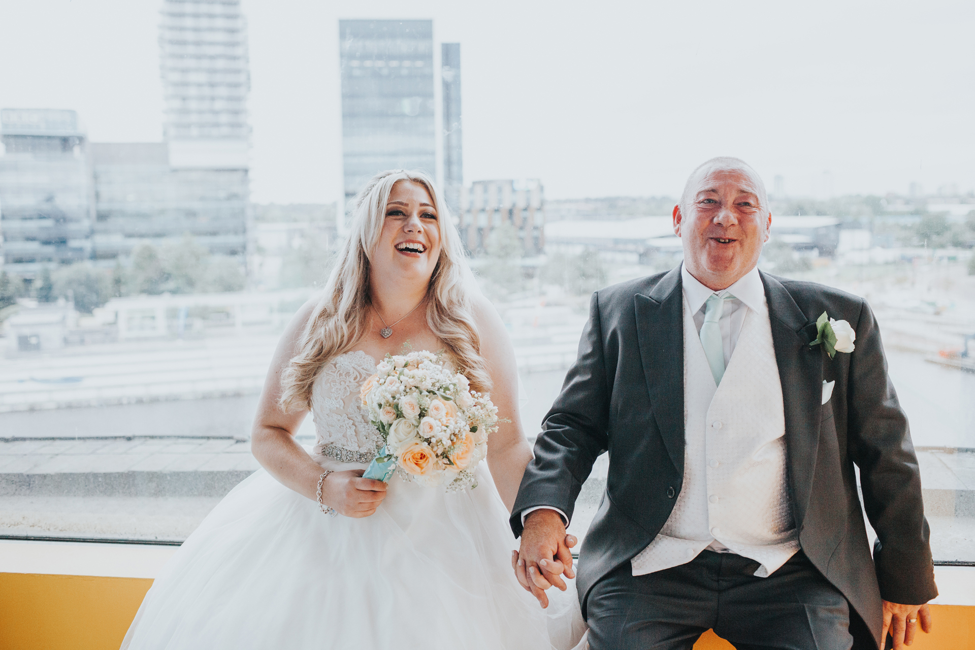 Bride and her father share a moment together before entering The Compass Room.