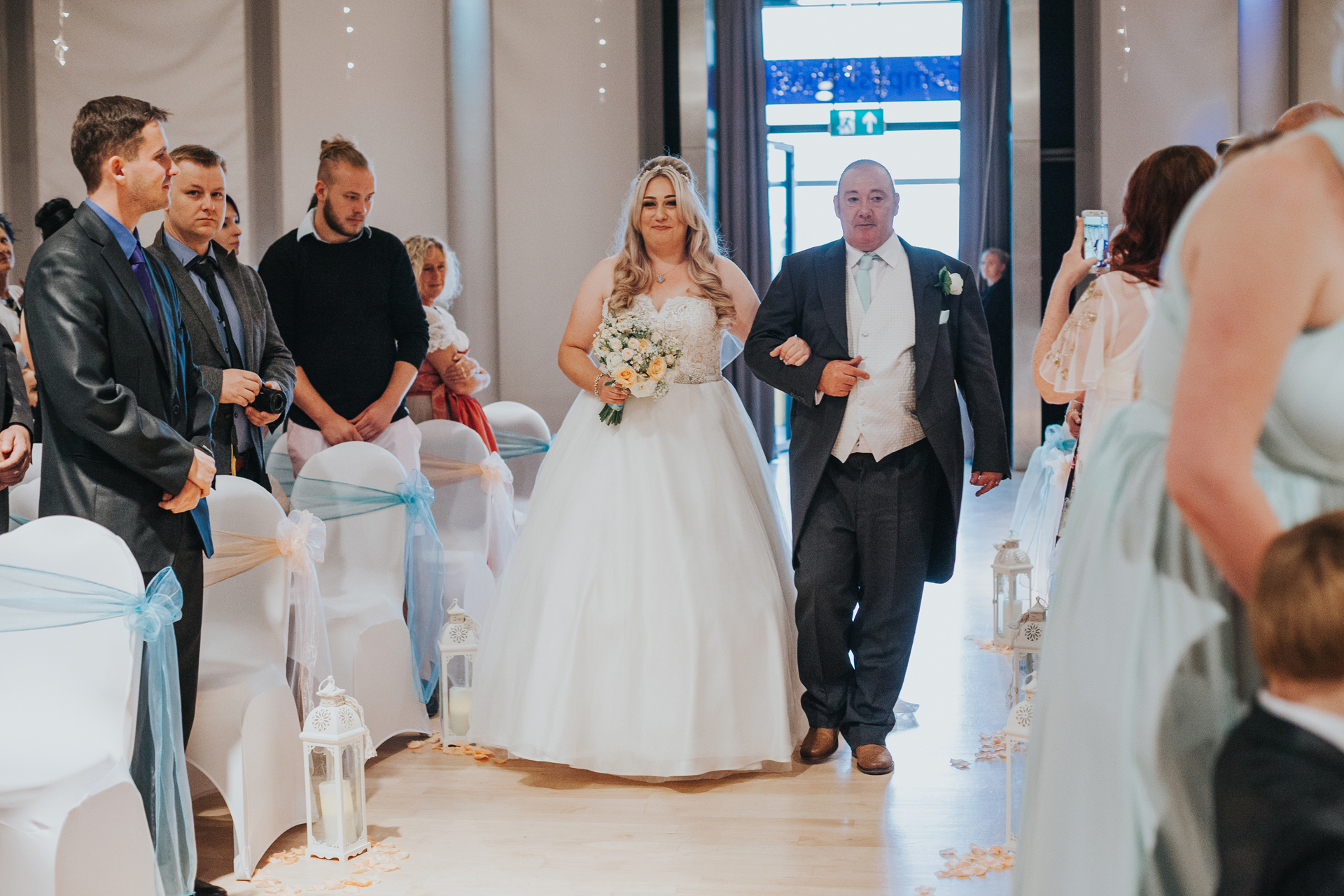 Bride and her father walk down the aisle in The Compass Room.