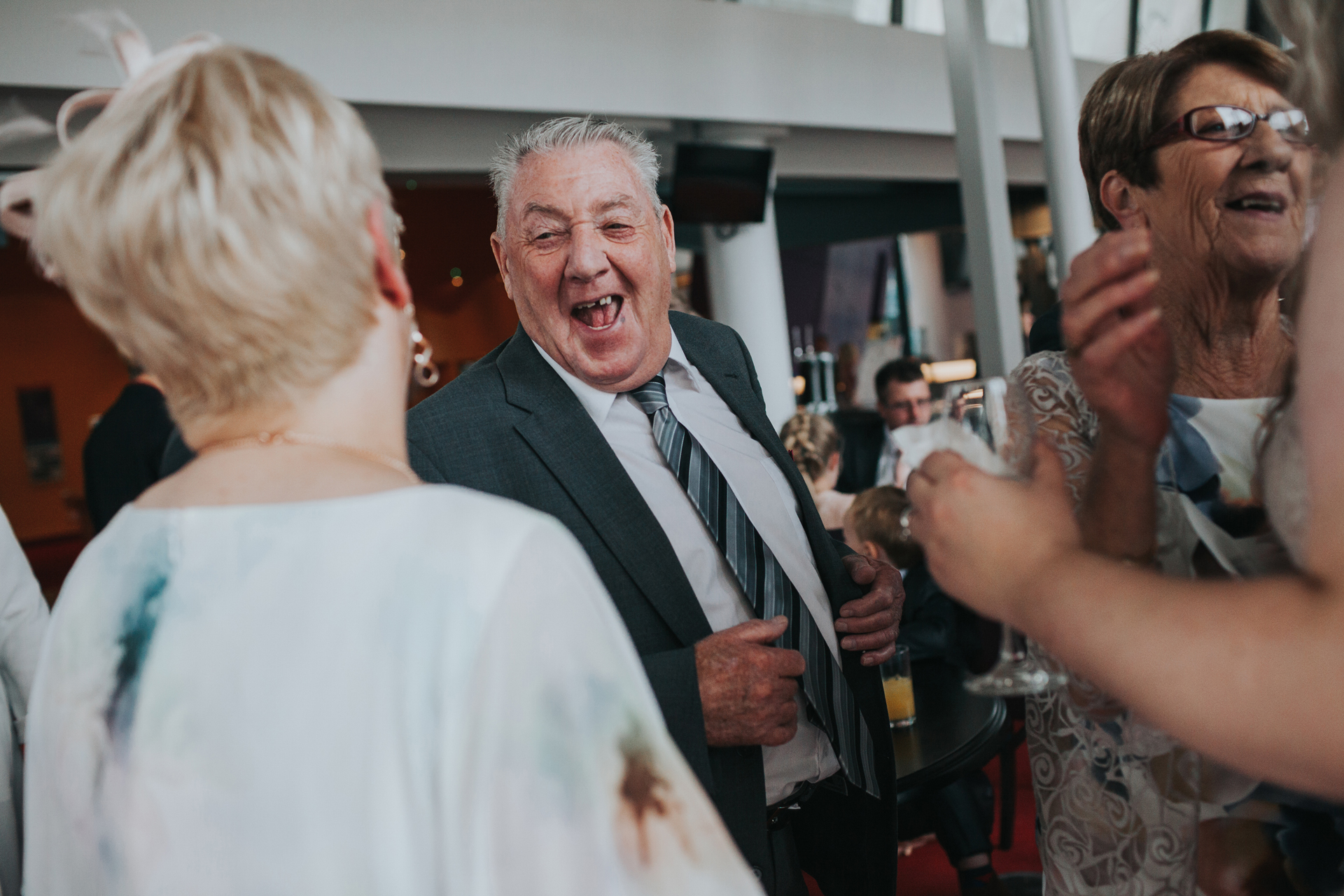 Wedding guests roars with laughter.