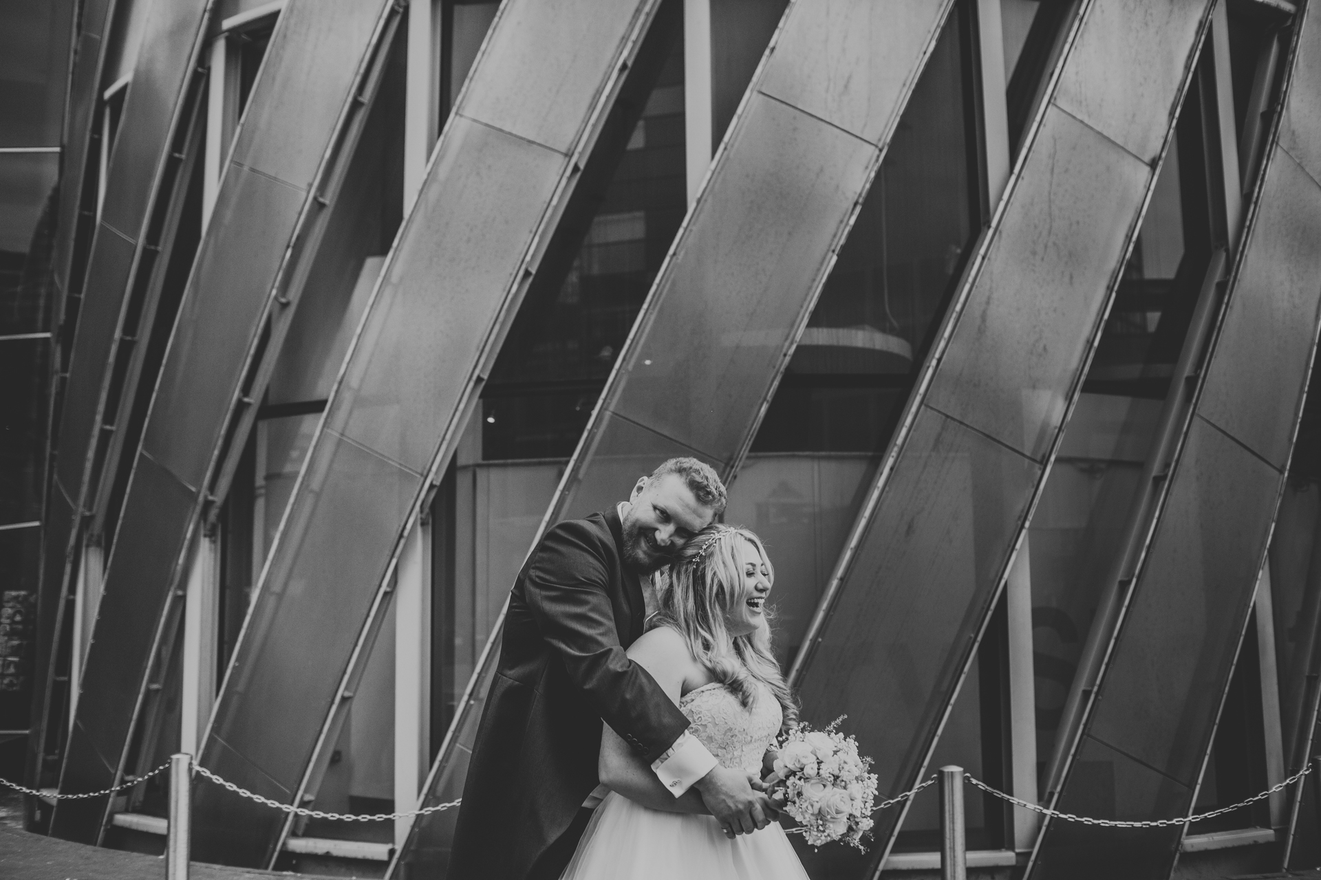 Black and white photo of bride and groom together.